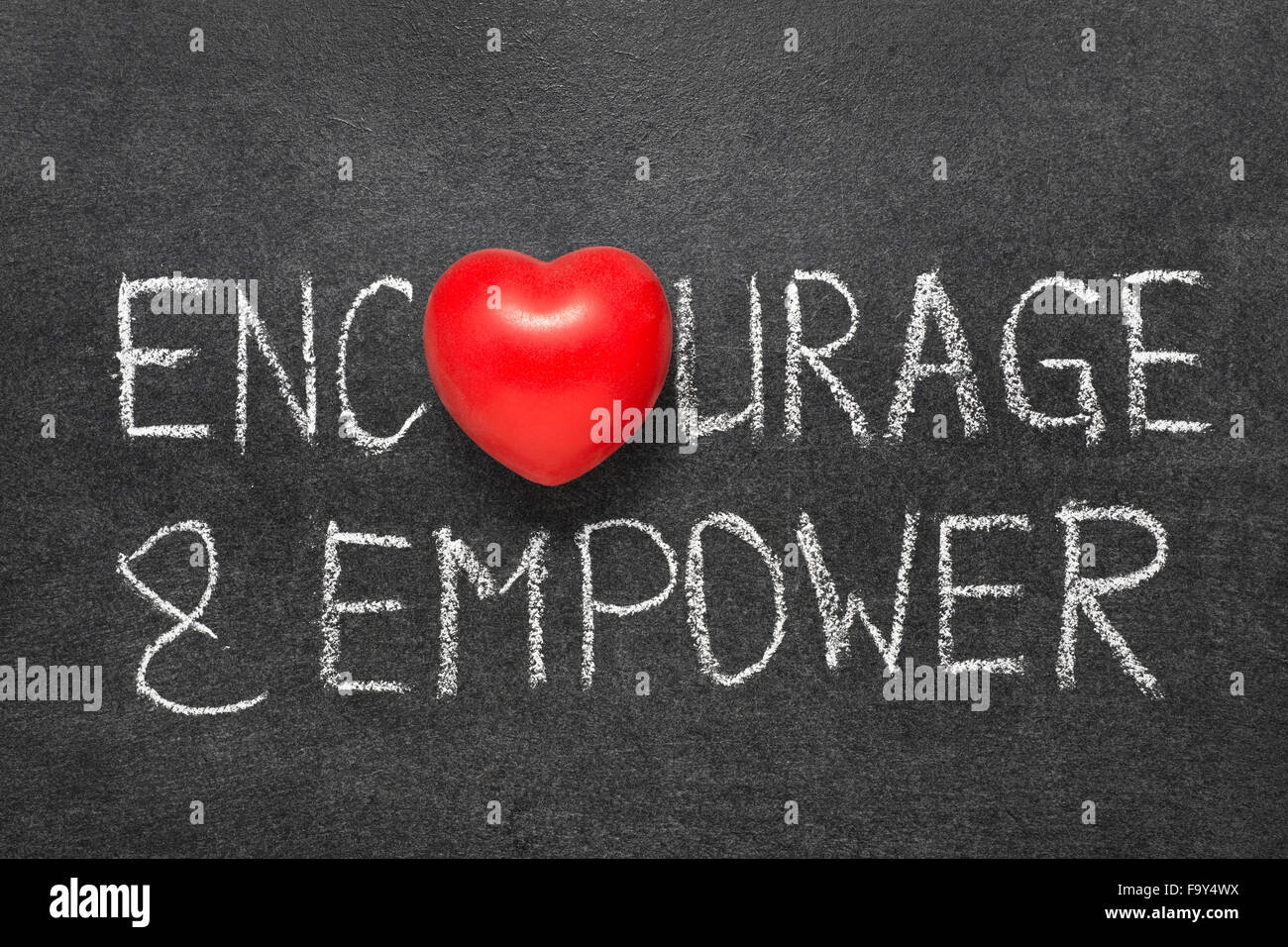 Encourage and empower words handwritten on blackboard with heart encourage and empower words handwritten on blackboard with heart symbol instead o biocorpaavc