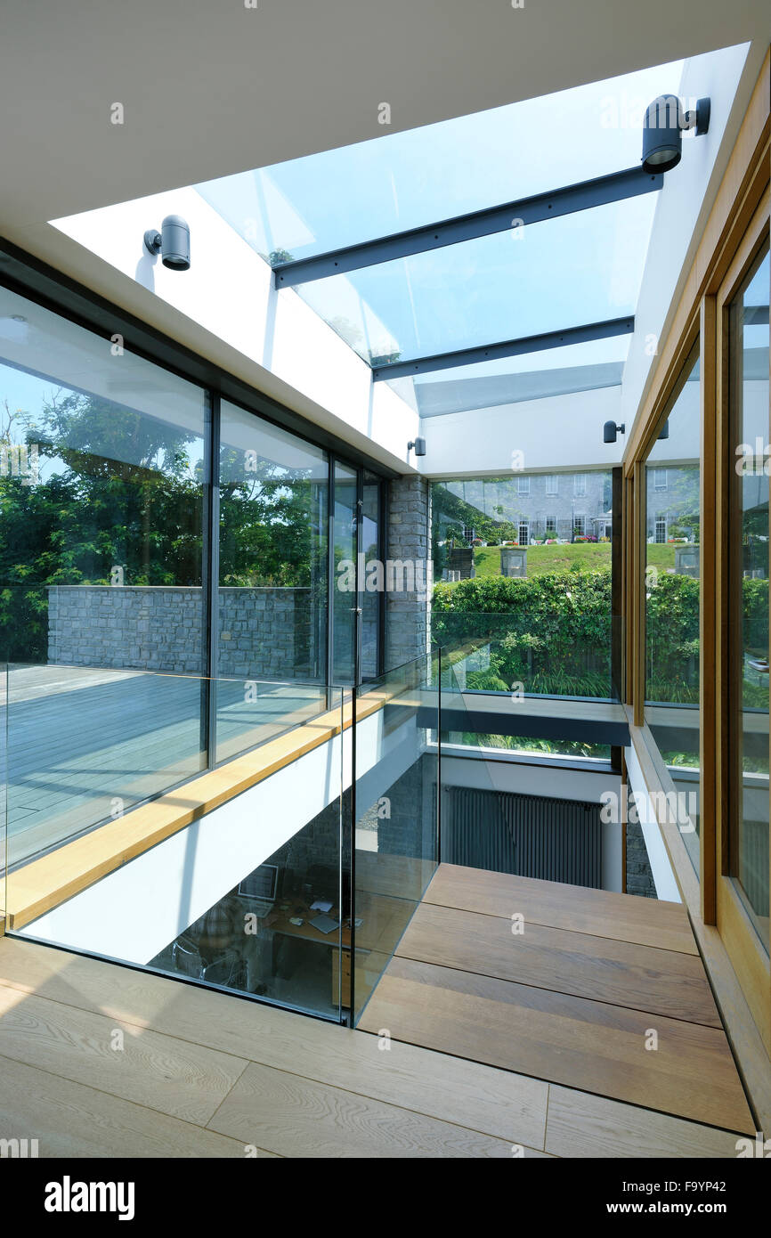 The interior of a modern house on the coast large sliding for Large glass sliding doors for houses