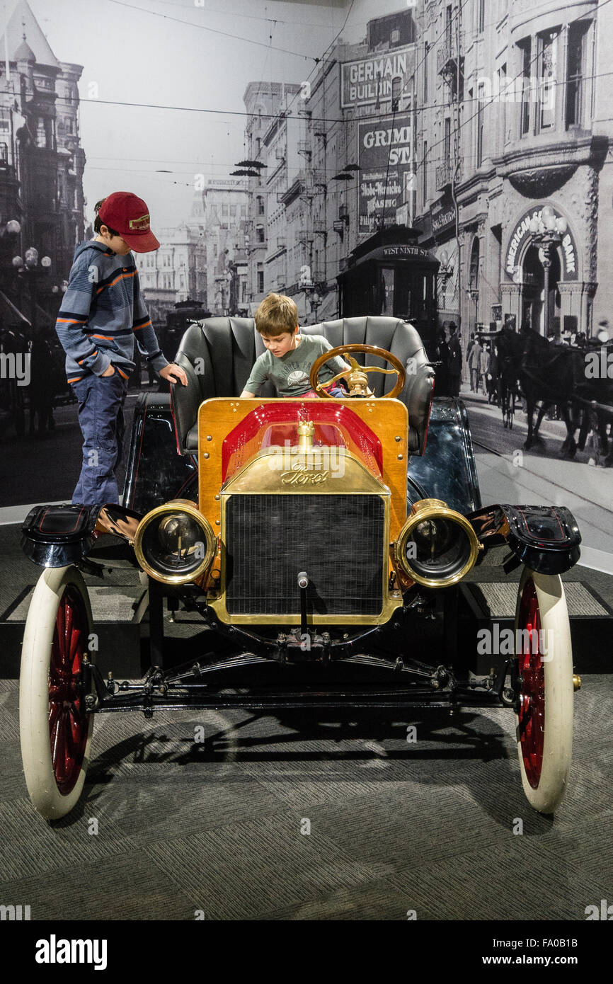 Two brothers check out an antique 1910 Ford Model T Roadster on ...