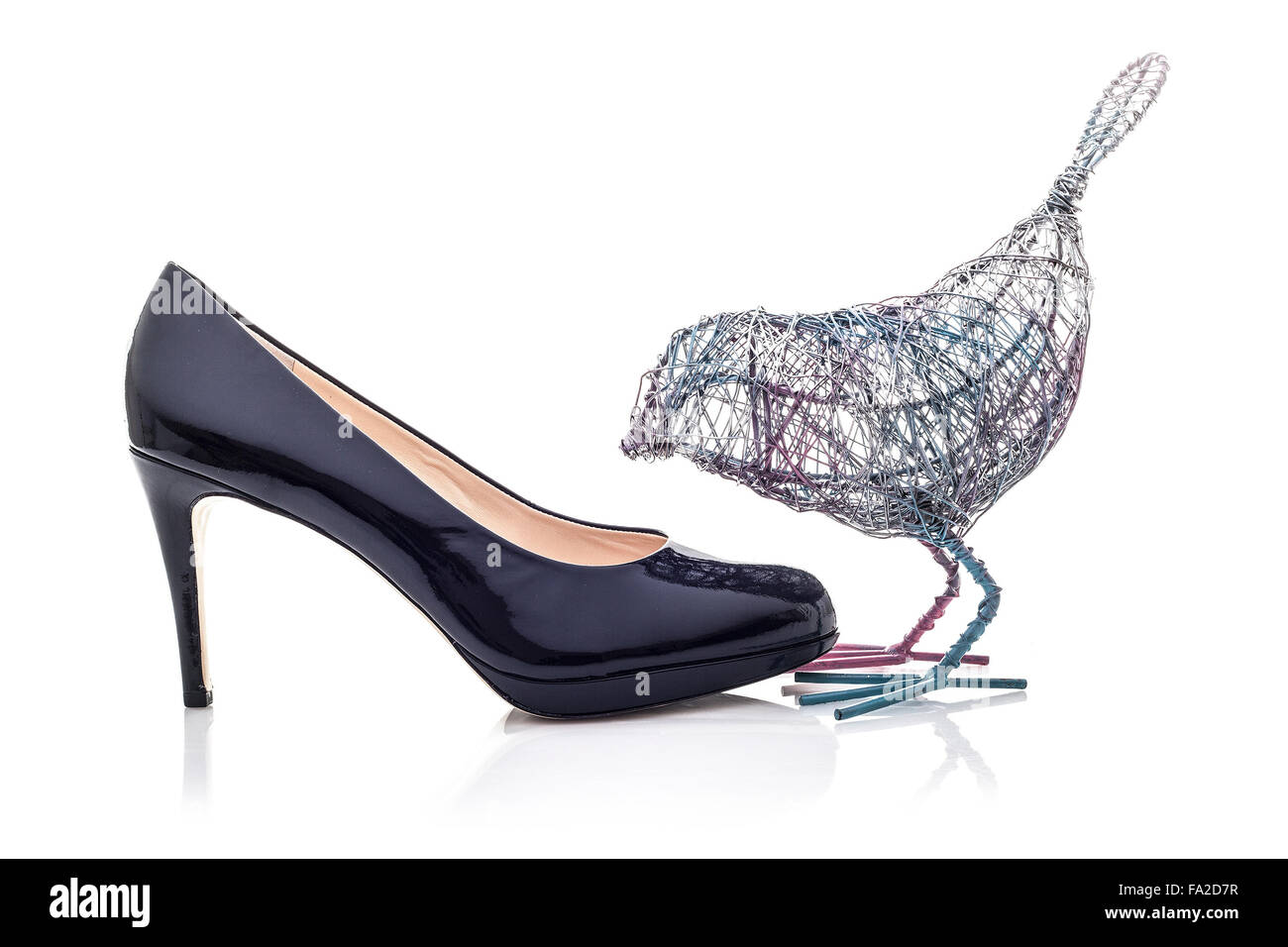 Wire Bird with High Heel shoe on a white background Stock Photo ...