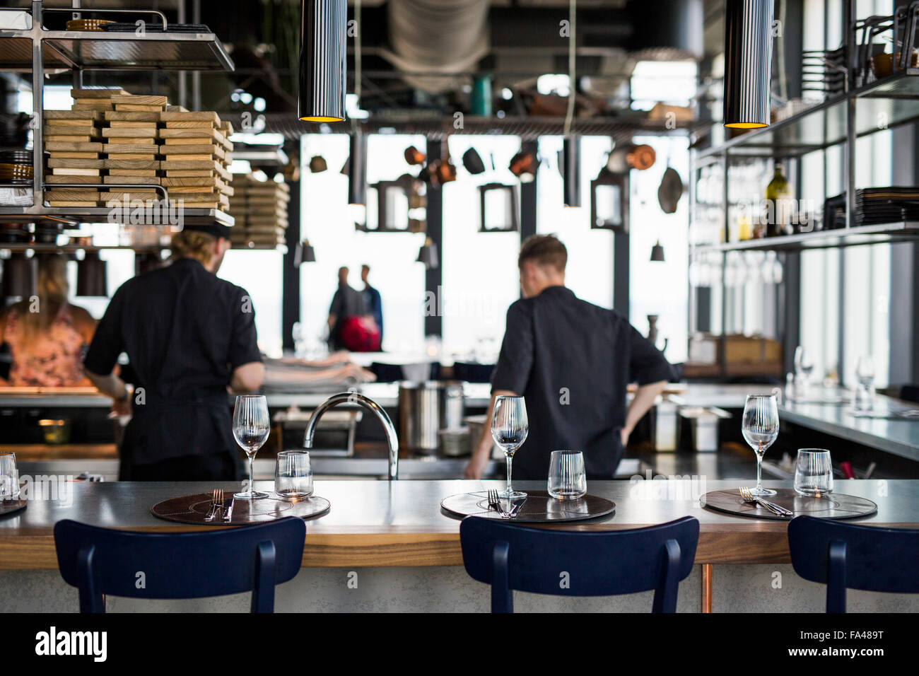 Restaurant Kitchen View rear view of chefs cooking food in kitchen at skybar restaurant