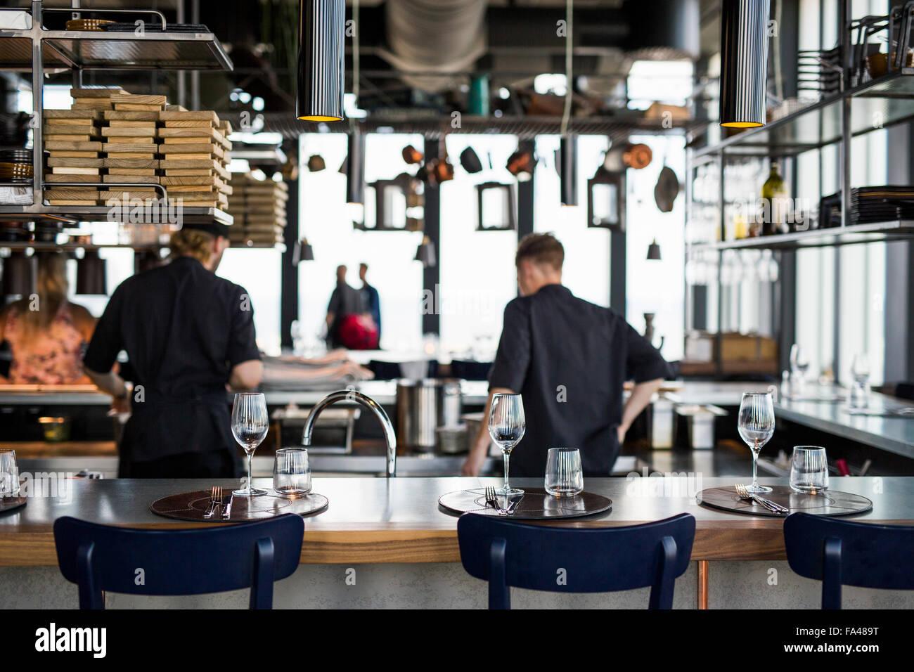 Restaurant Kitchen View rear view of chefs cooking food in kitchen at skybar restaurant