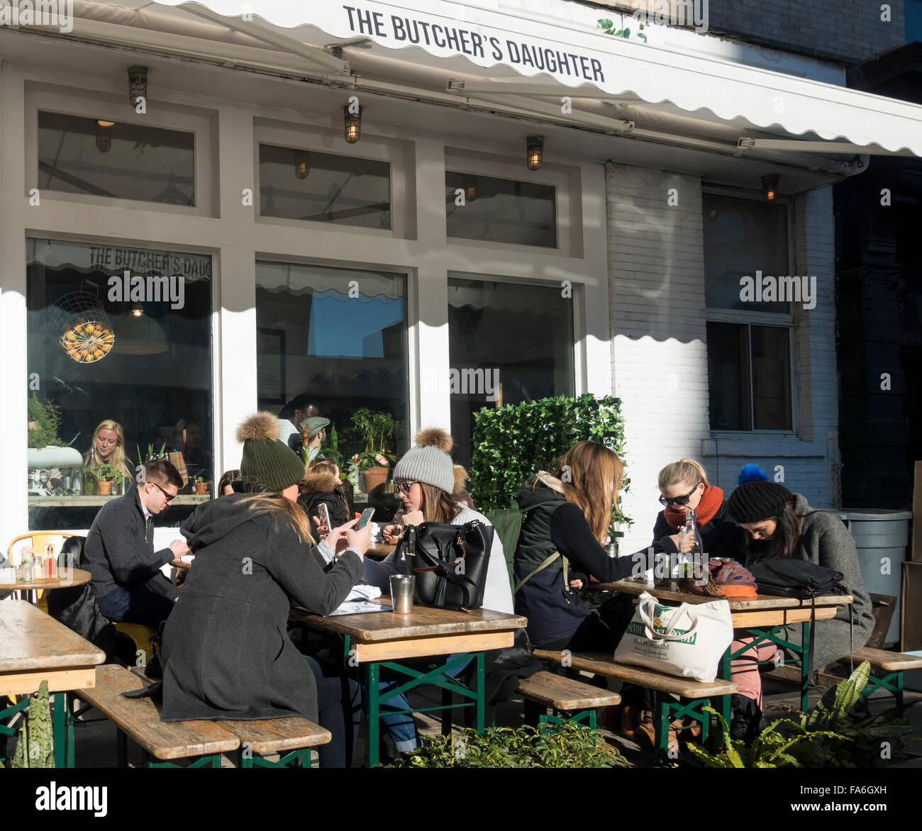 Good Alfresco Dining At An Outdoor Cafe On A Cold Day In New York, With Everyone