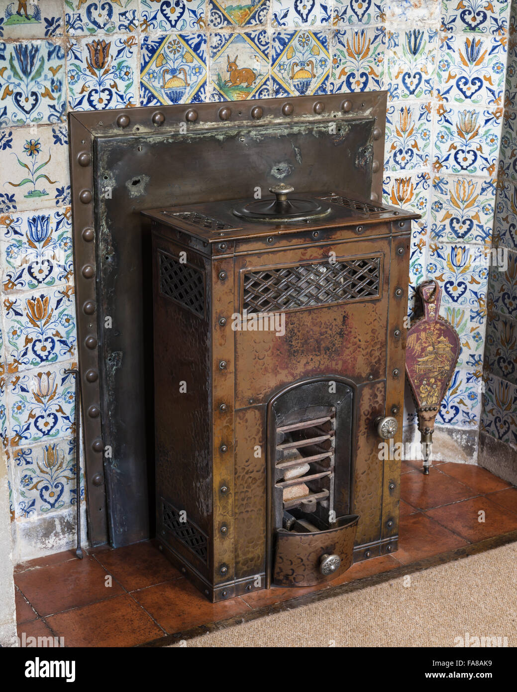 A pither stove in the fireplace in the Dining Room at Bateman's ...