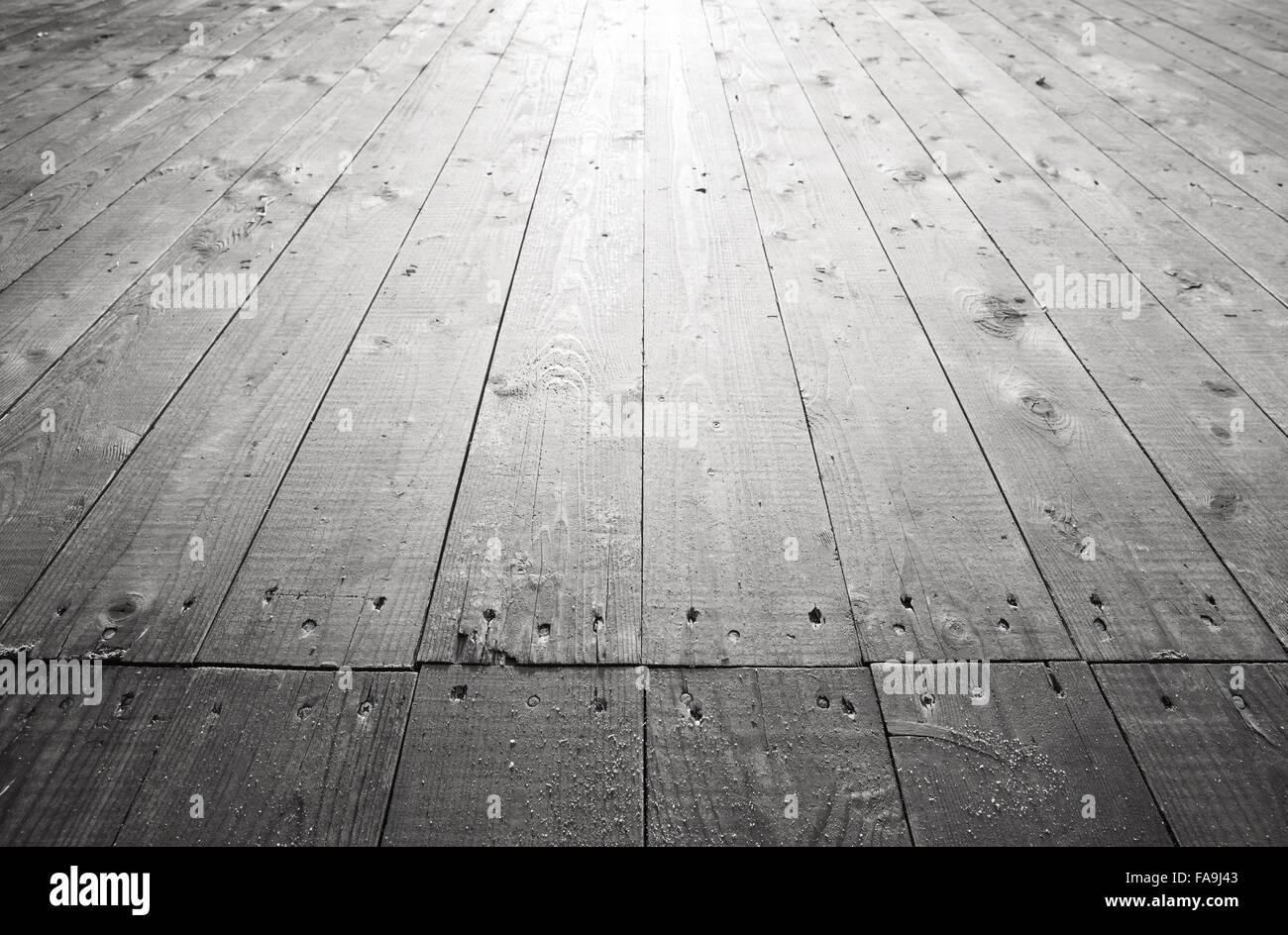 Old gray wooden floor background texture with perspective effect. Old gray wooden floor background texture with perspective effect