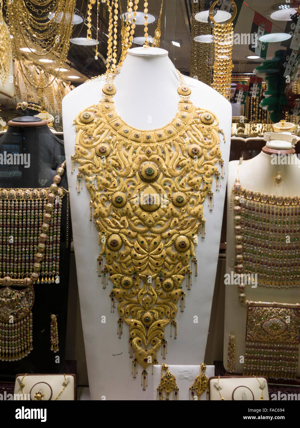Window display of gold necklace and ornaments in Dubai gold souk ...