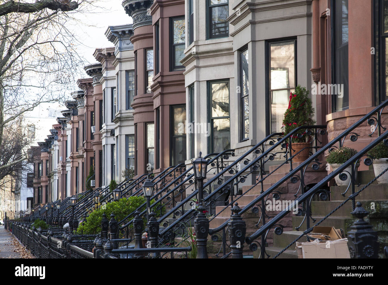 Typical residential street lined with brownstone type for Buying a house in brooklyn
