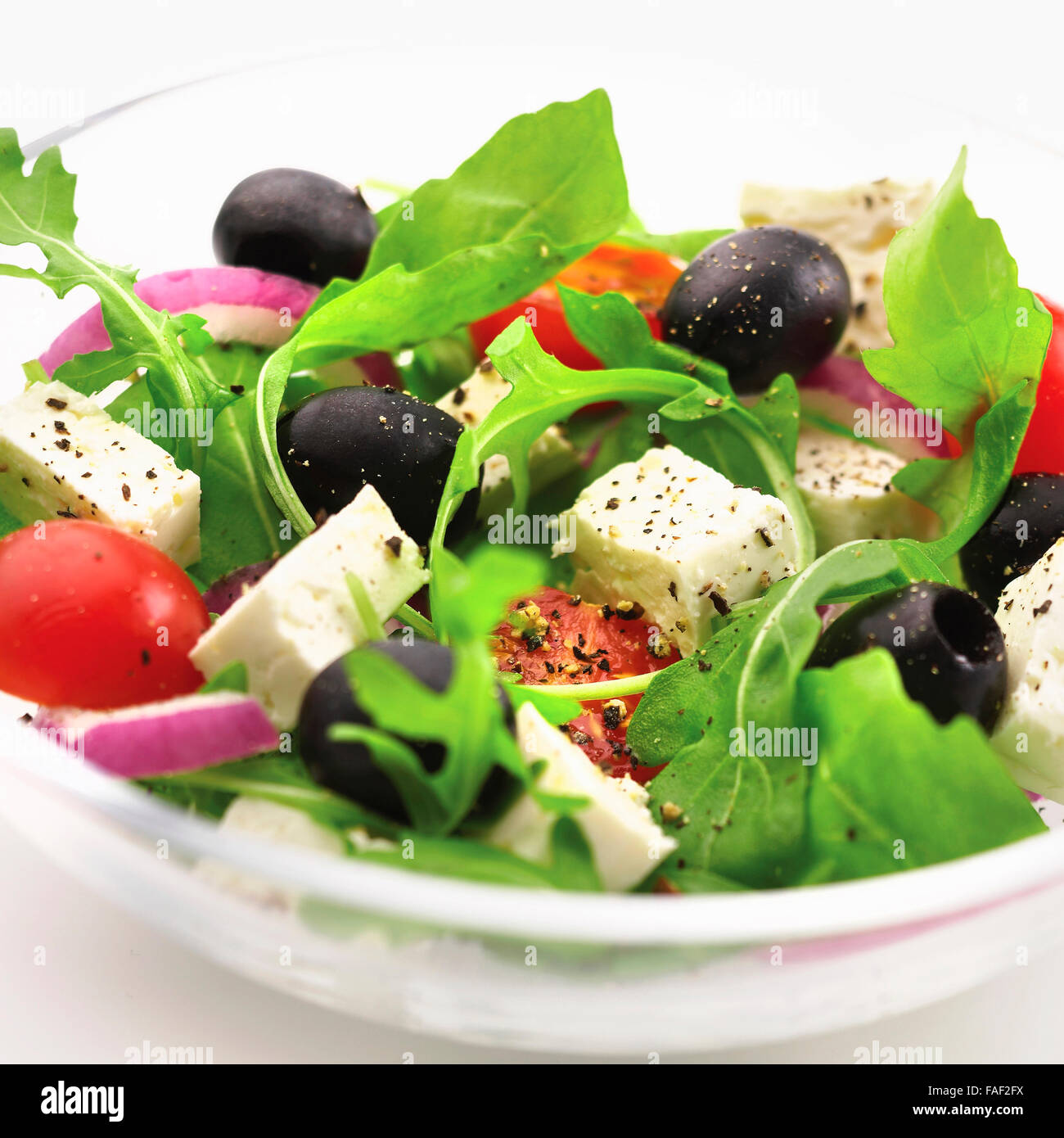 Mixed Greek Salad With Fresh Rocket Leaves Olives Feta Cheese Tomato Onion And Black Pepper