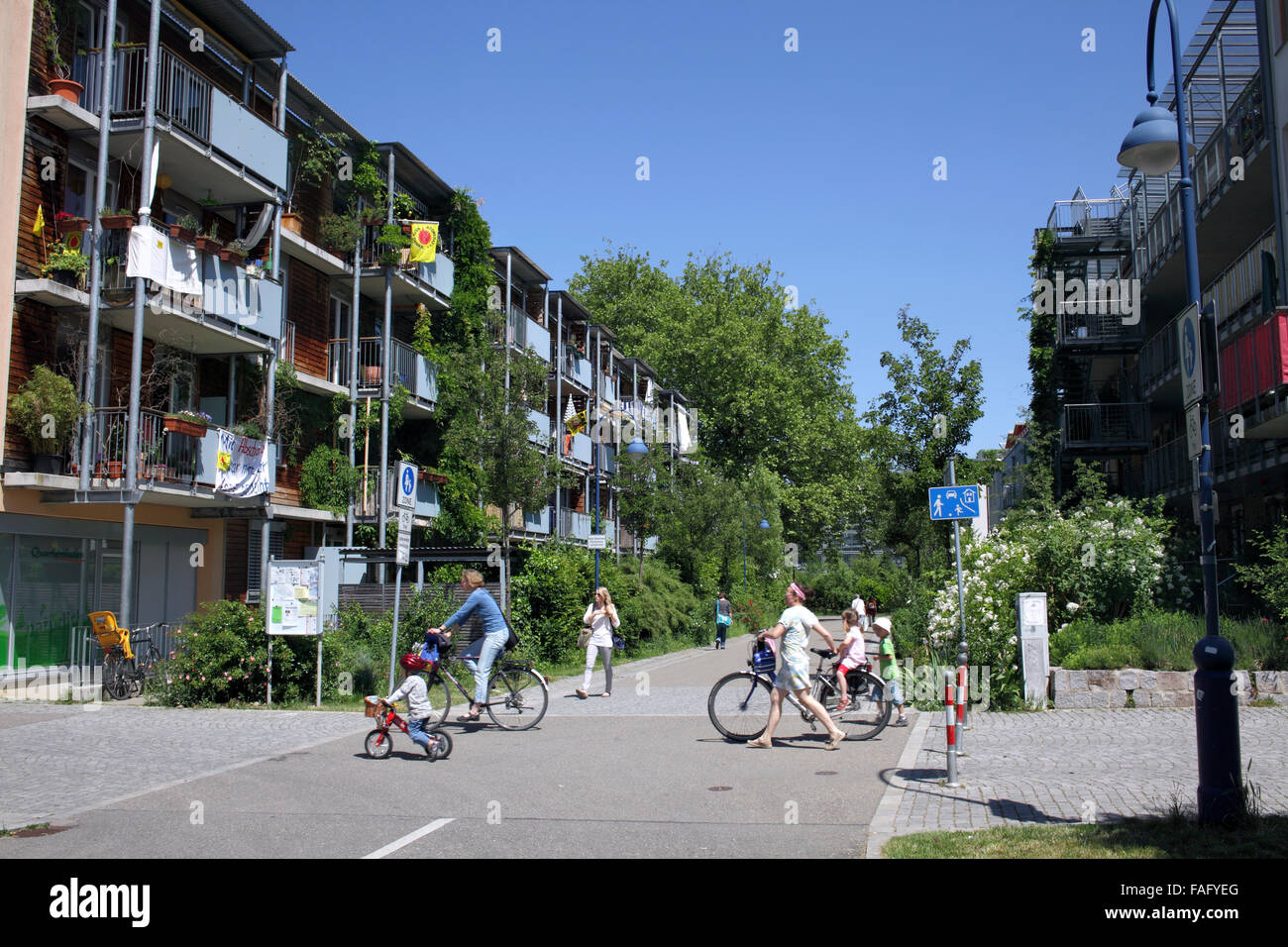 housing and cyclists in the green suburb of vauban freiburg stock photo royalty free image. Black Bedroom Furniture Sets. Home Design Ideas