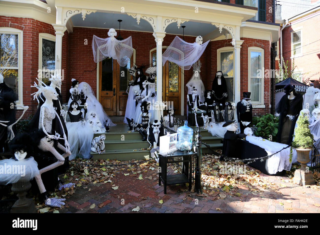 A house decked with lots of figures as part of a beetle juice style halloween decoration