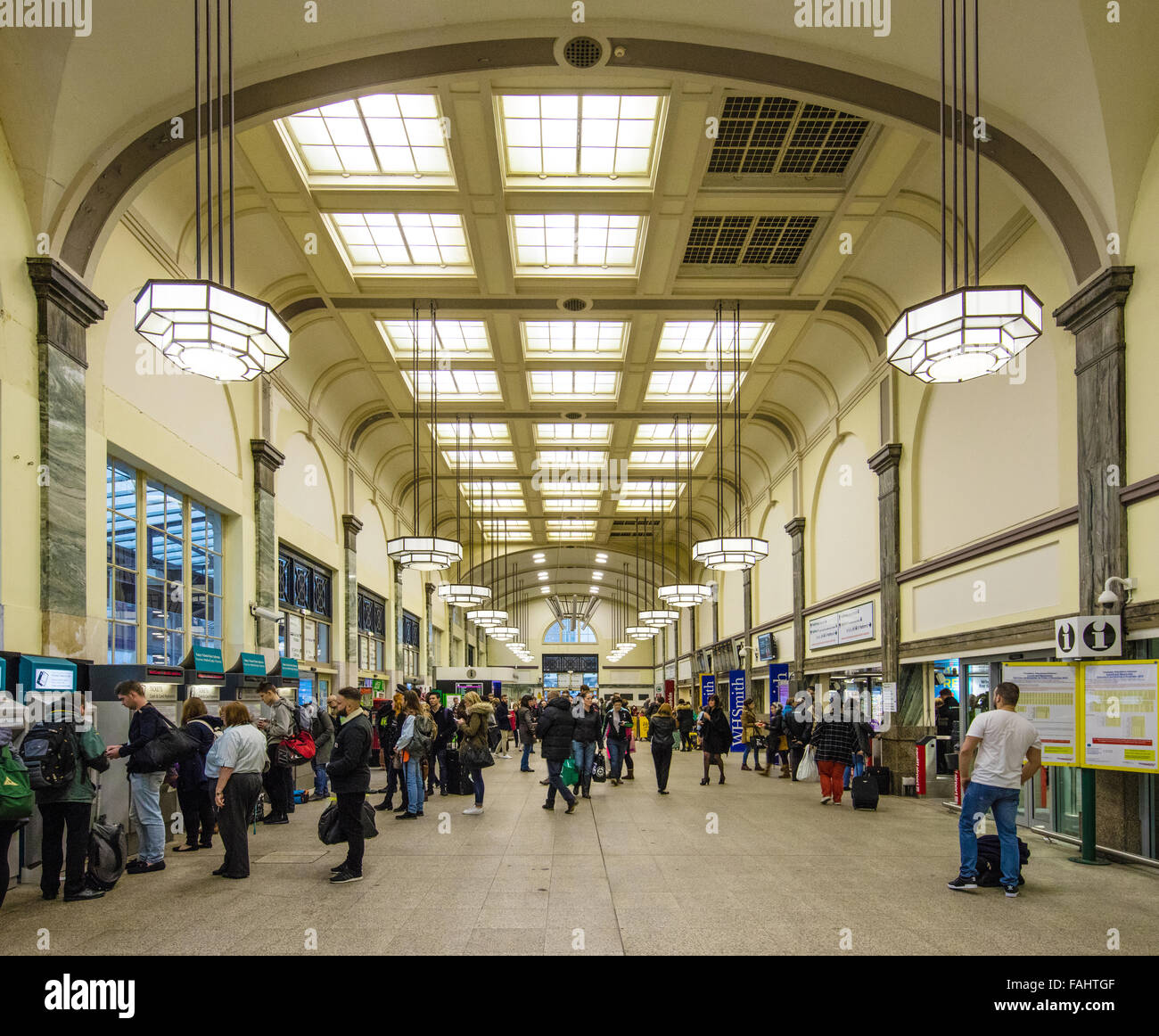 art deco interior of cardiff central railway station in wales busy