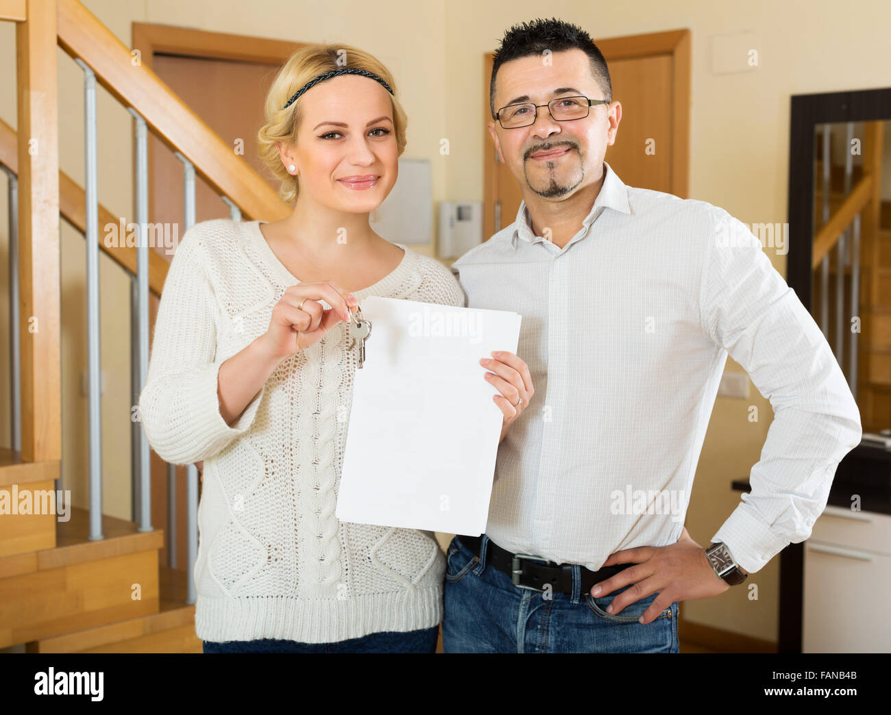 Happy husband and wife signing a contract and buying apartment ...