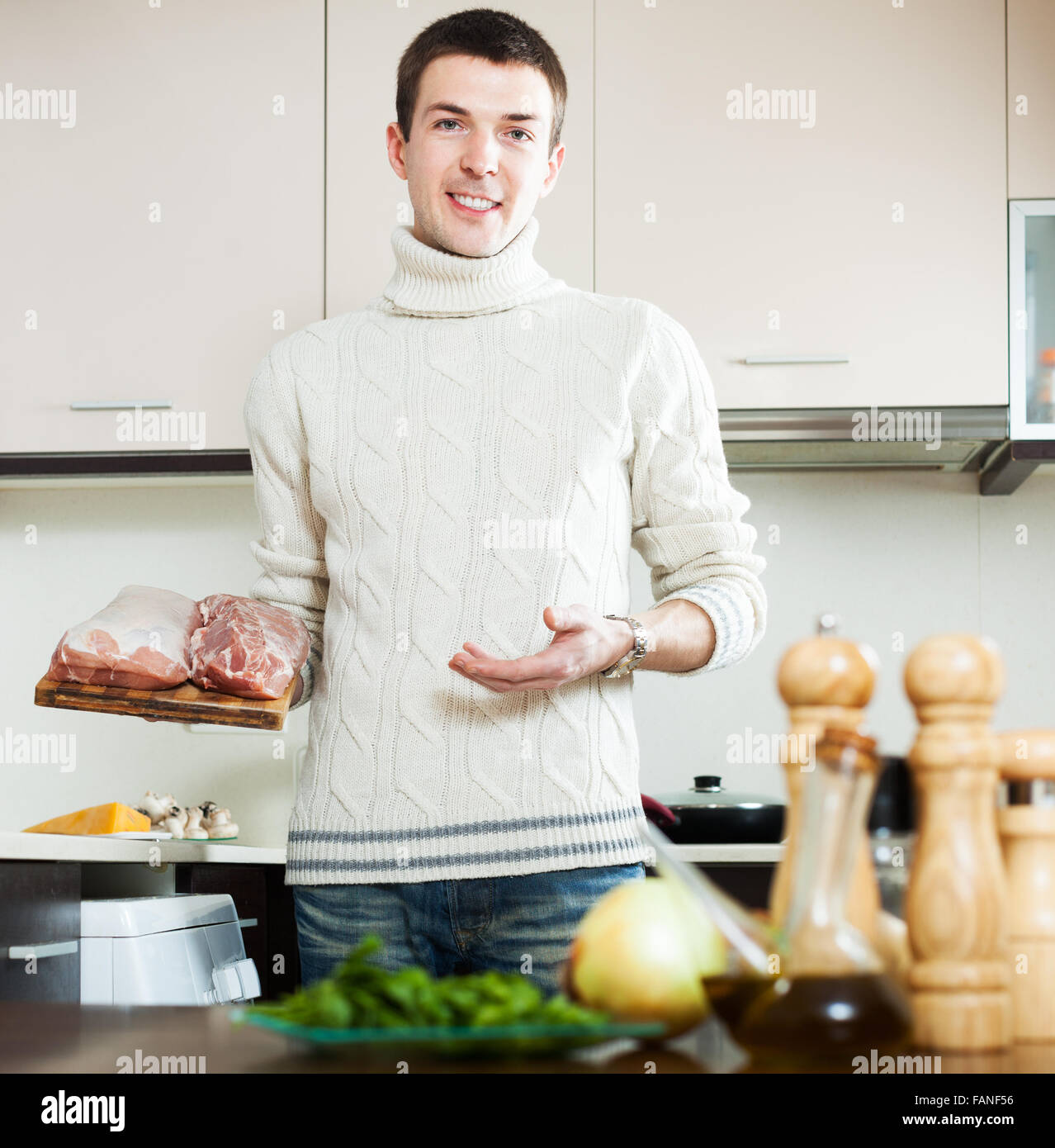 Home Kitchen Cooking Smiling Guy Cooking Meat At Home Kitchen Stock Photo Royalty Free