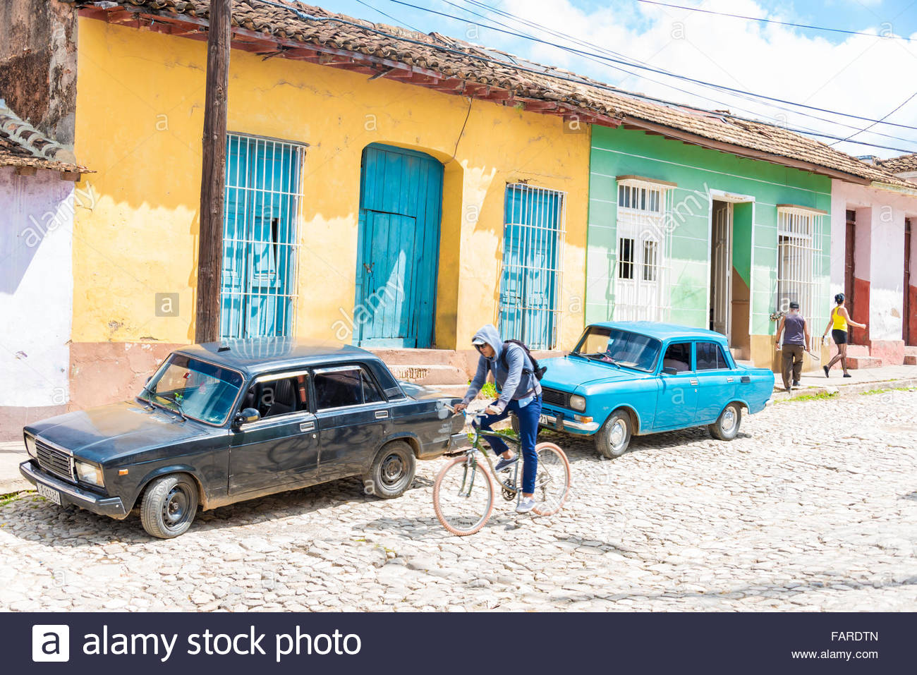 Parked Cars And Hispanic Colonial Houses In Trinidad De Cuba Man