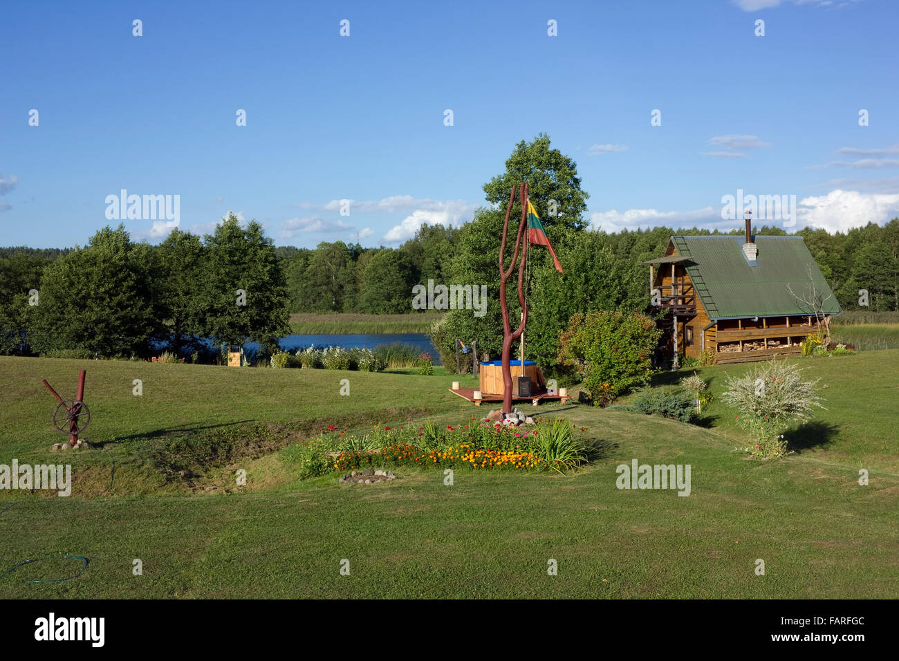 stock photo vilnius lithuania august 29 2015 lithuanian flag and flowers bed near the tourists rustic hotel and bath in a year lithu - Rustic Hotel 2015