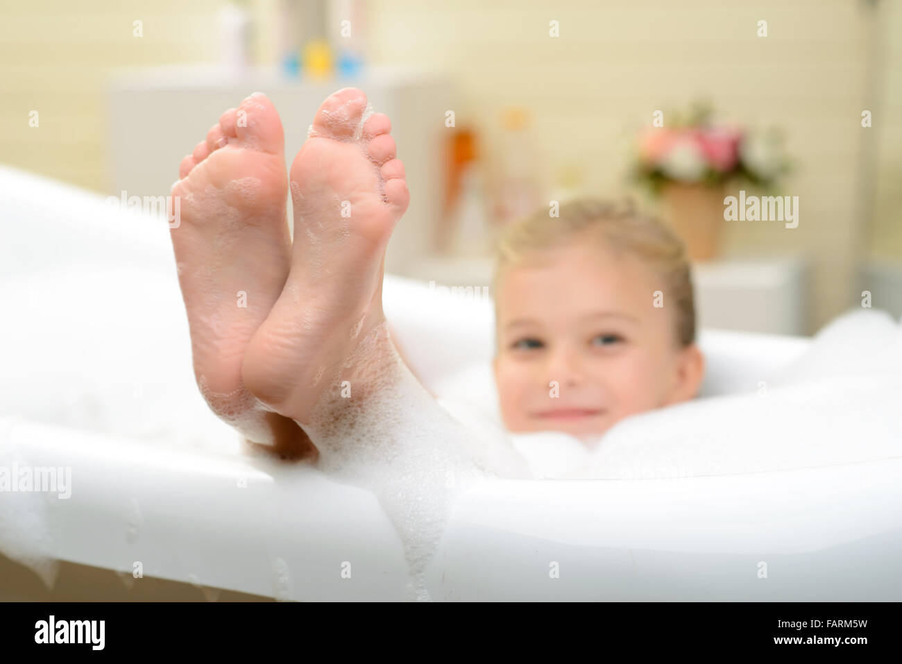 pleasant little girl playing in bath tube stock photo royalty free image 92719141 alamy. Black Bedroom Furniture Sets. Home Design Ideas