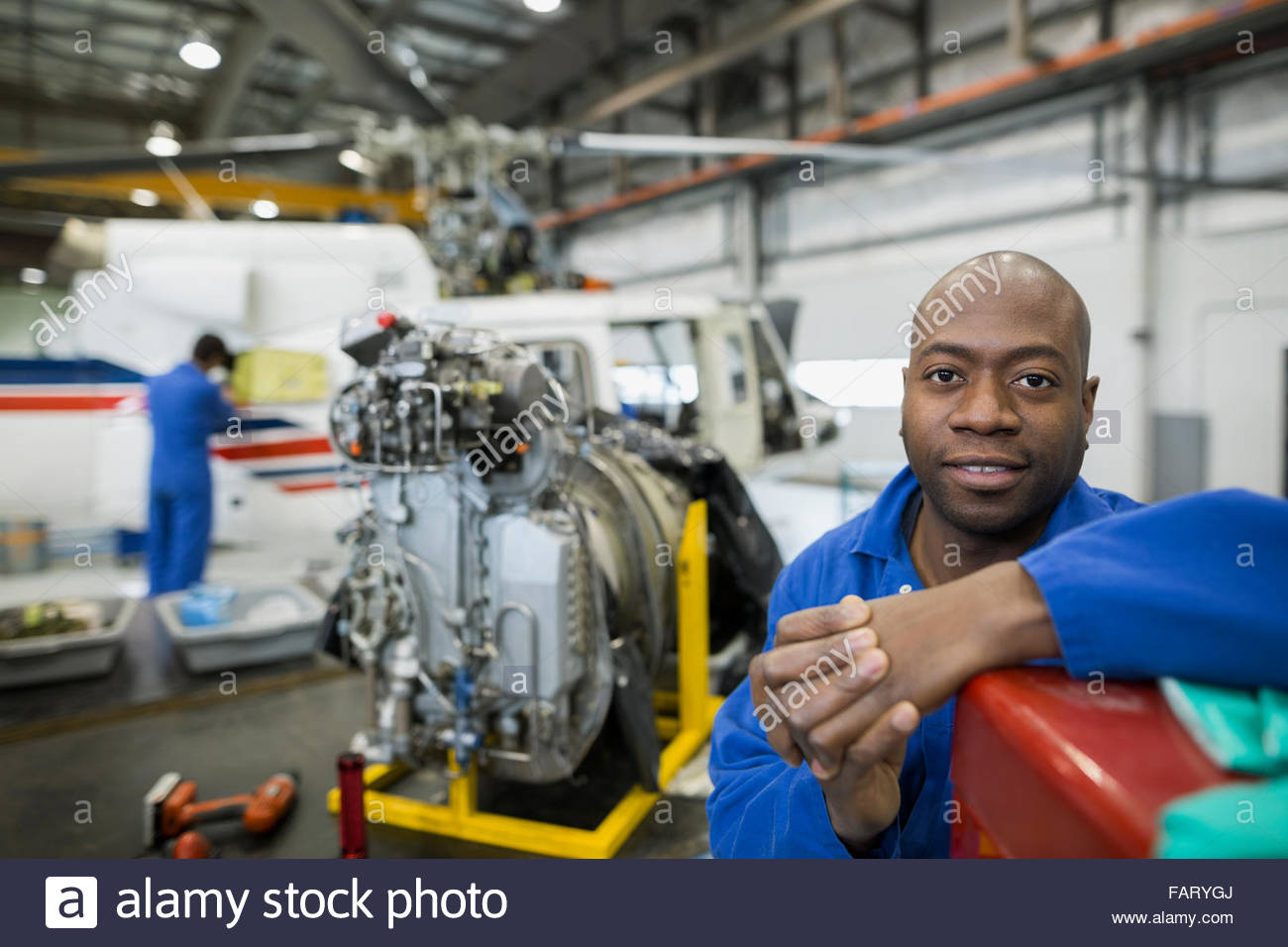 Portrait Confident Helicopter Mechanic In Airplane Hangar Stock ...