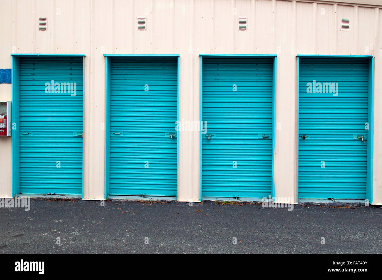 Set Of Four Metal Roll Up Doors Of Storage Units, Closed And Locked