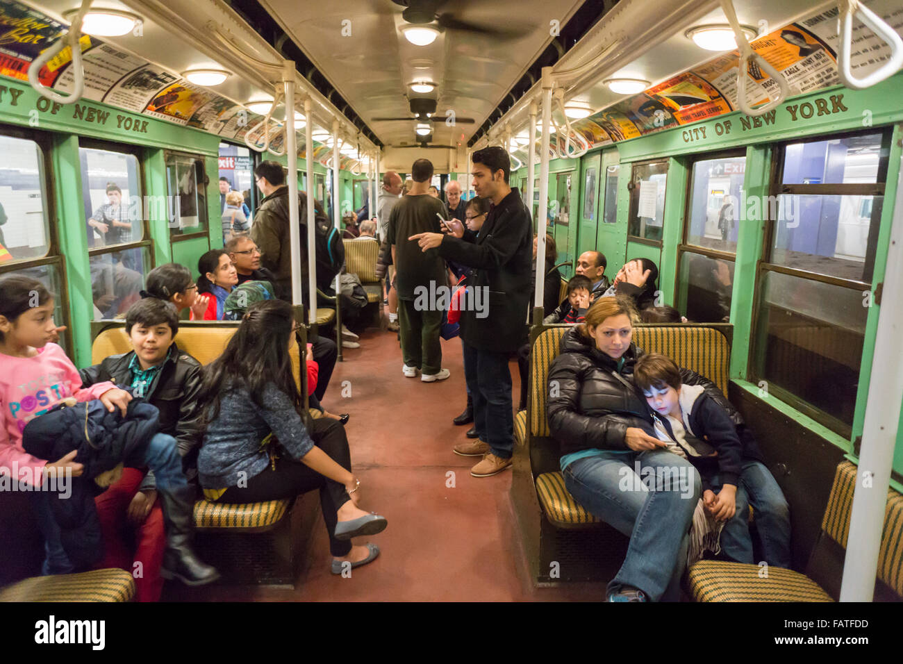 New Yorkers, tourists and subway buffs travel on a vintage MTA ...