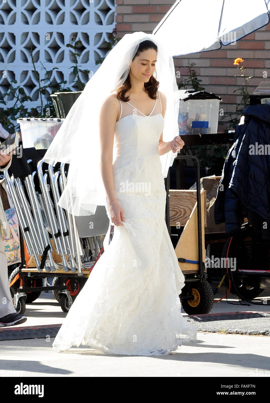 Actress Emmy Rossum looking flawless in a wedding dress as she ...