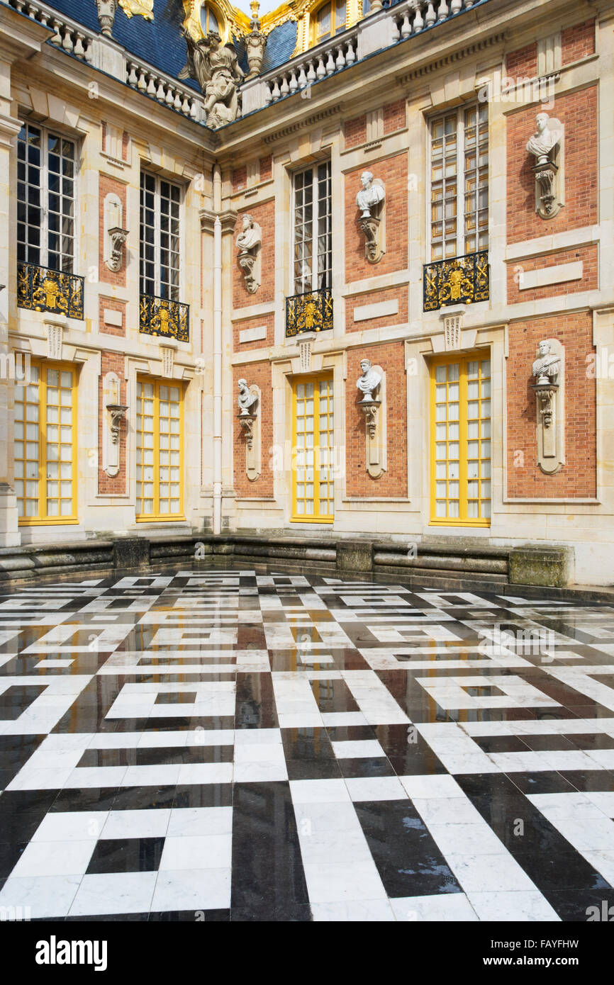 Chateau de versailles entrance courtyard with black and white chateau de versailles entrance courtyard with black and white tiled floor versailles france dailygadgetfo Images