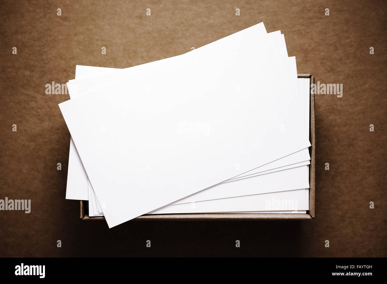 Business cards in box on dark brown cardboard background Stock ...