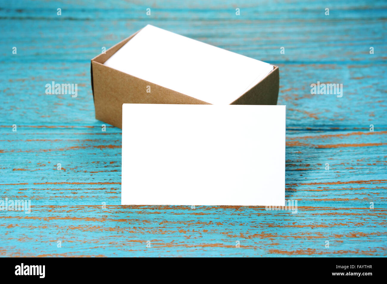 Blank business card with brown paper box on wood desk Stock Photo ...