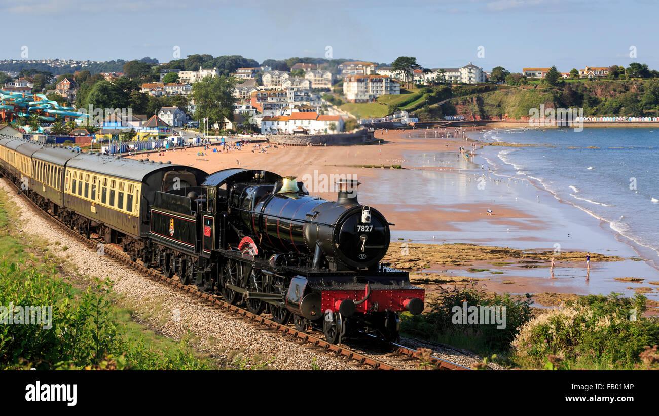 7827 Lydham Manor hauls a train past Goodrington Sands ...
