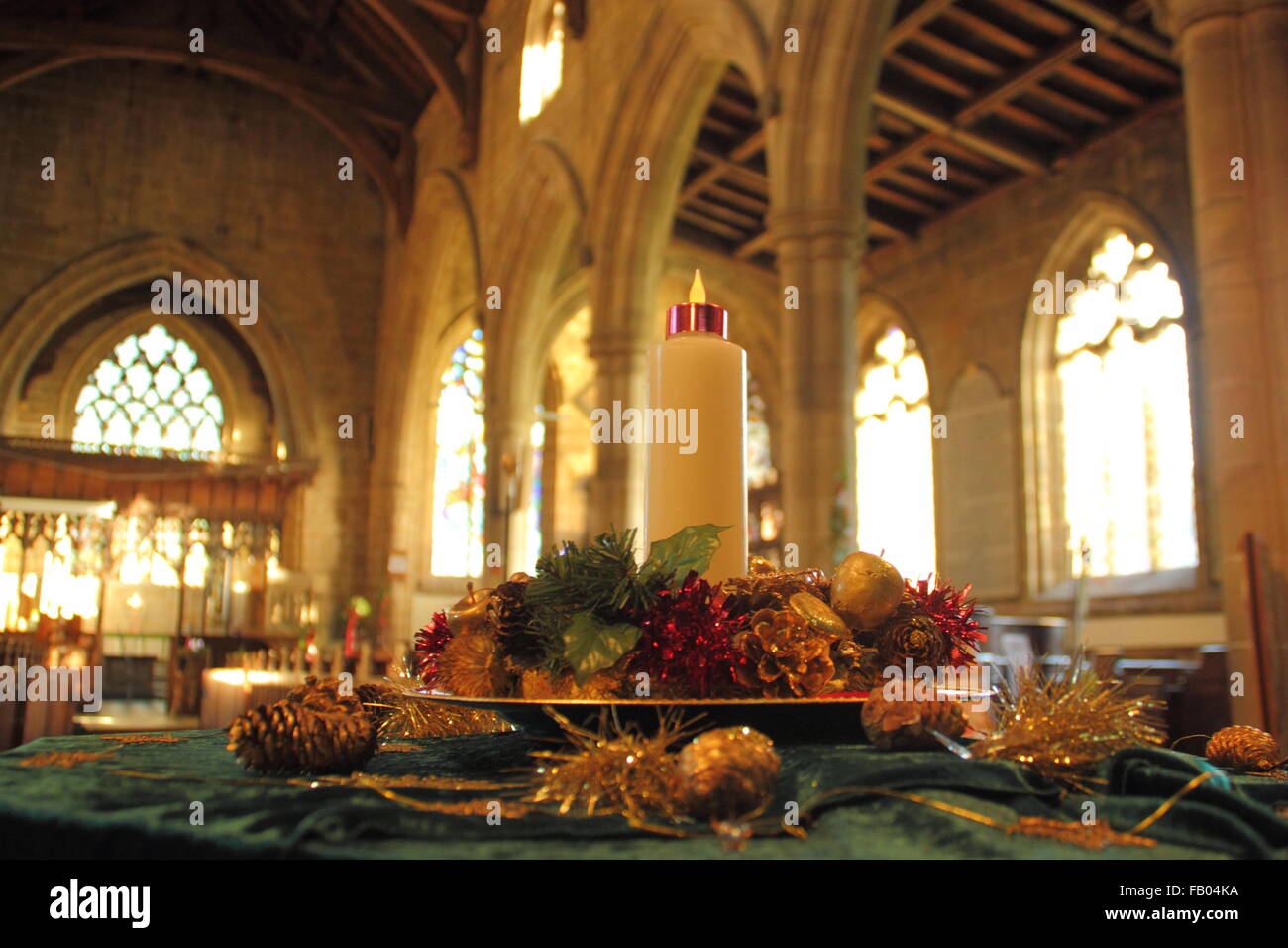 a christmas candle inside st john the baptist church at tideswell