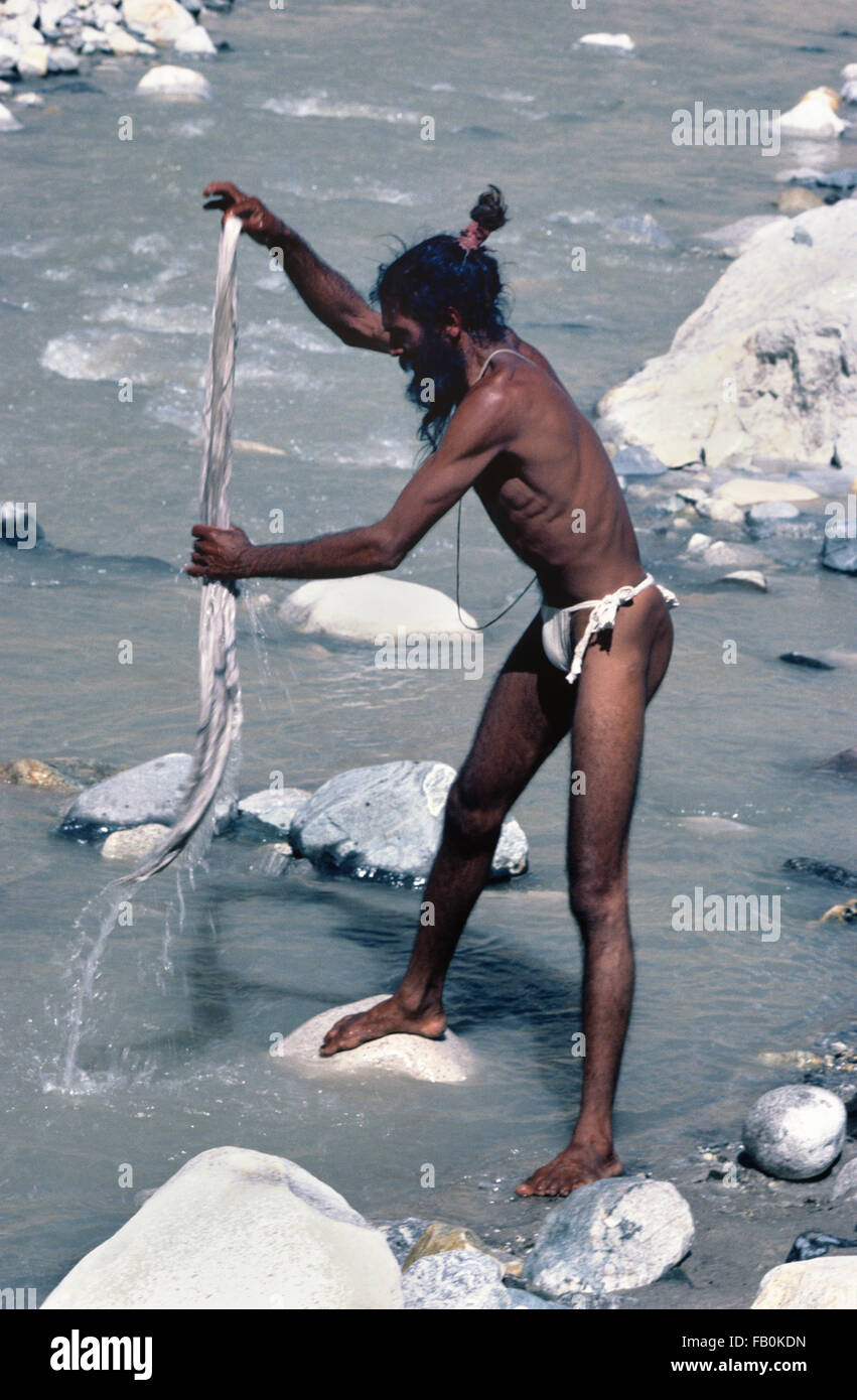 loincloth  boy Hindu Saddhu or Indian Holy Man Washing Loin Cloth at Gaumukh at the Source  of the