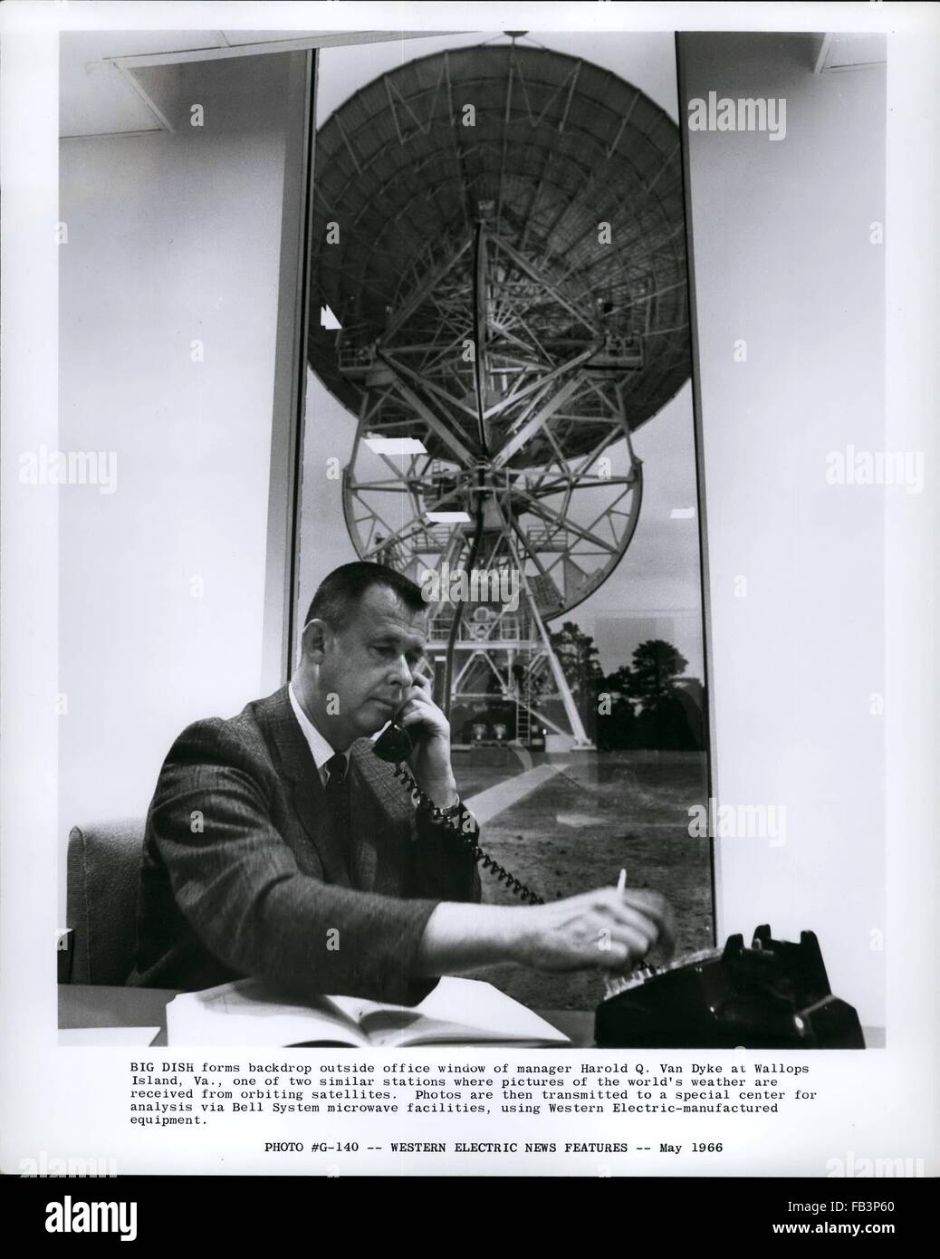1968 - Big Dish forms backdrop outside office window of manager Harold Q.  Van Dyke