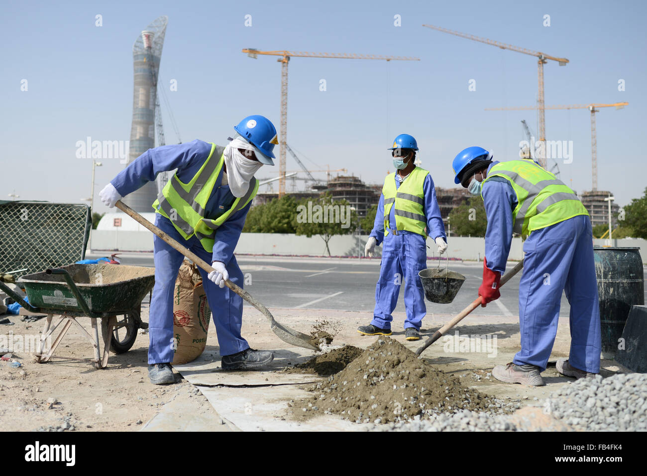 Construction workers from sri lanka work at a construction for Site in construction