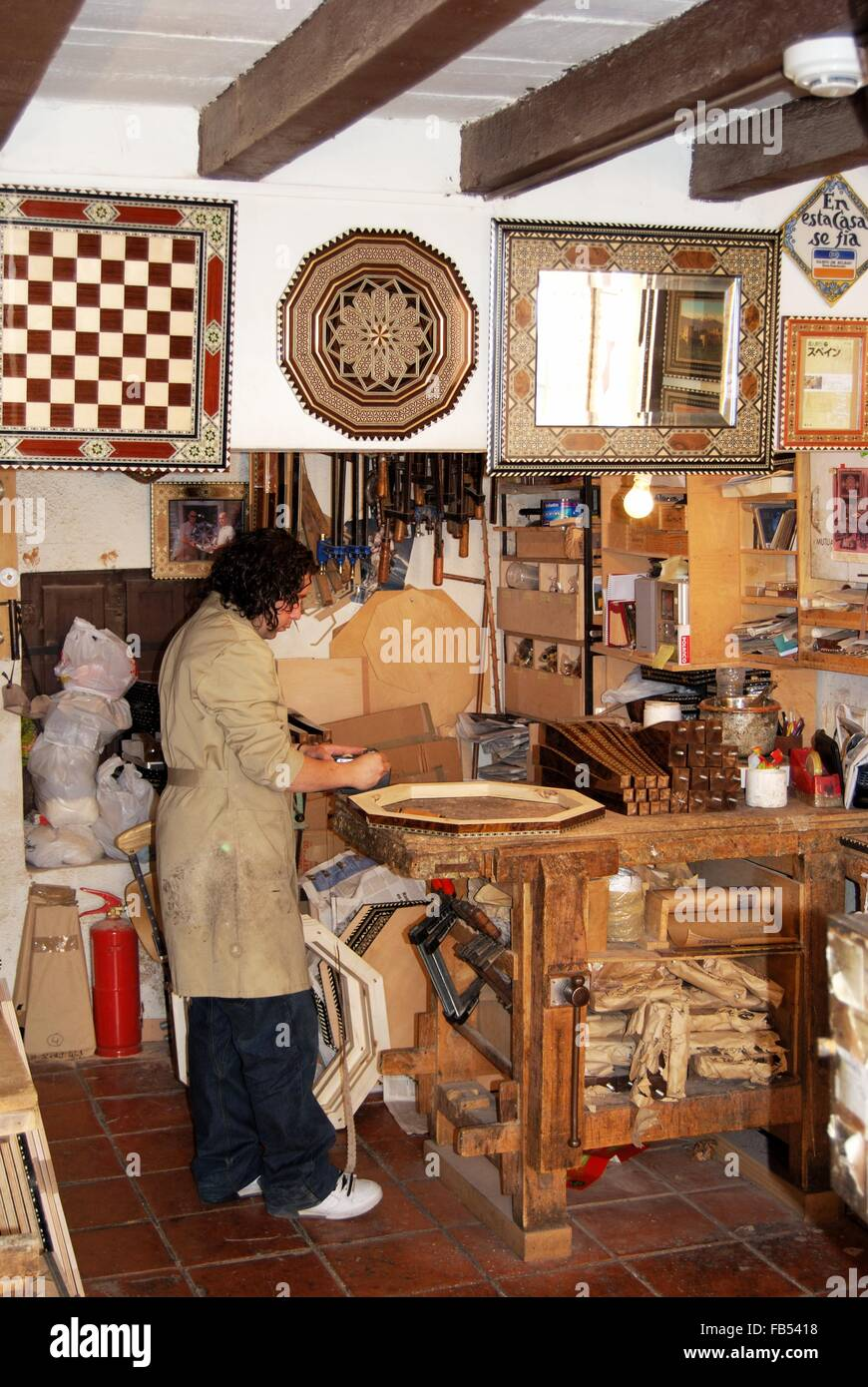 A Carpenter Making Moroccan Style Furniture Inside A Workshop, Palace Of  Alhambra, Granada, Granada Province, Andalusia, Spain,