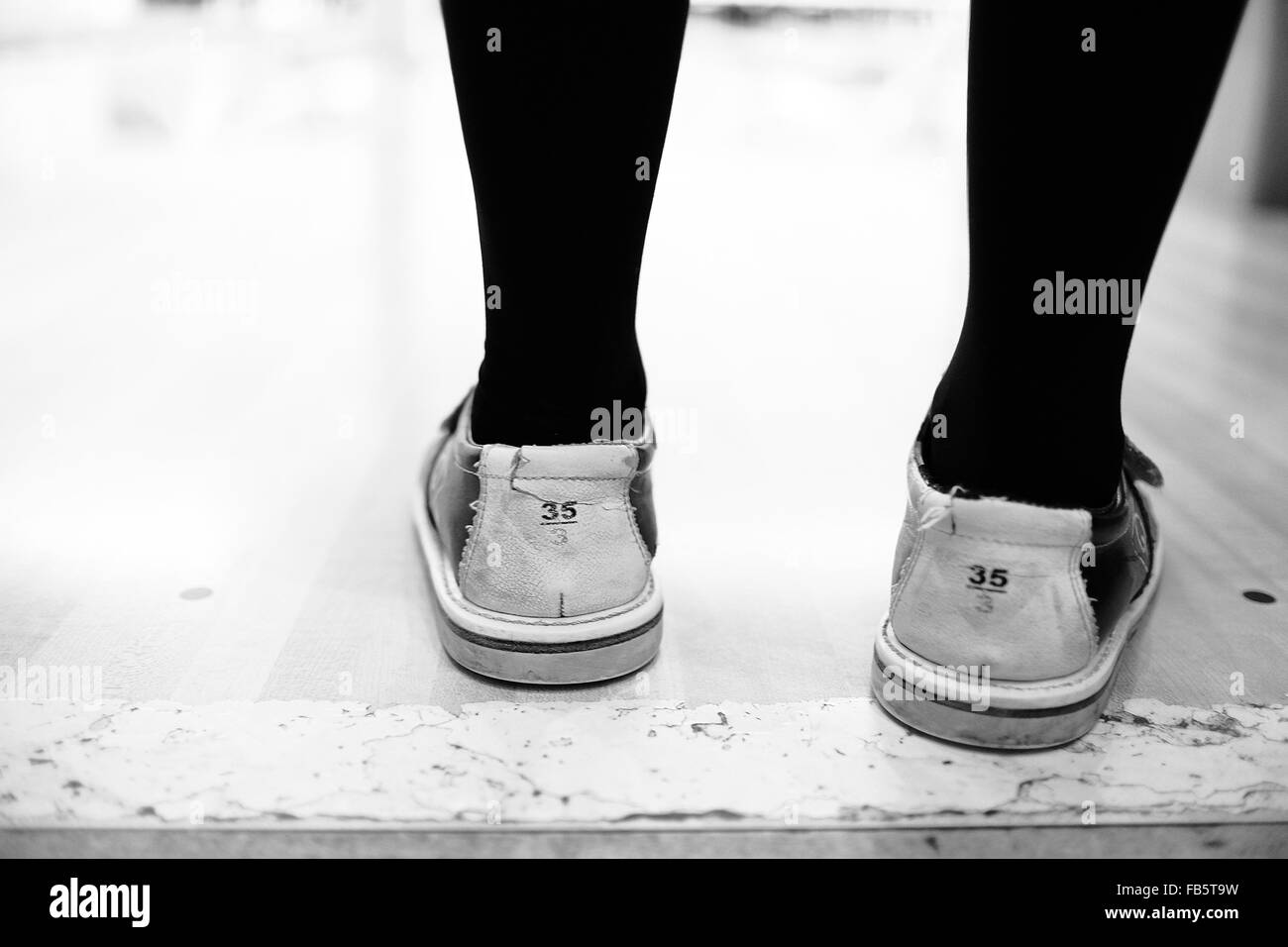 Girl's Feet In Bowling Shoes In A Bowling Alley. Size Euro 35, Uk ...