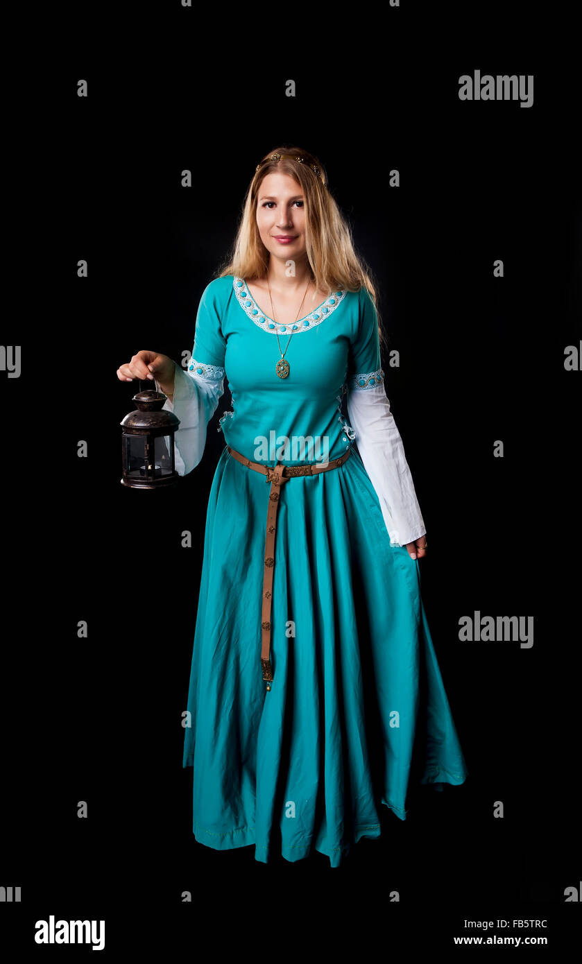 Studio shot of beautiful girl dressed in a medieval turquoise ... for Girl Holding Lamp  177nar