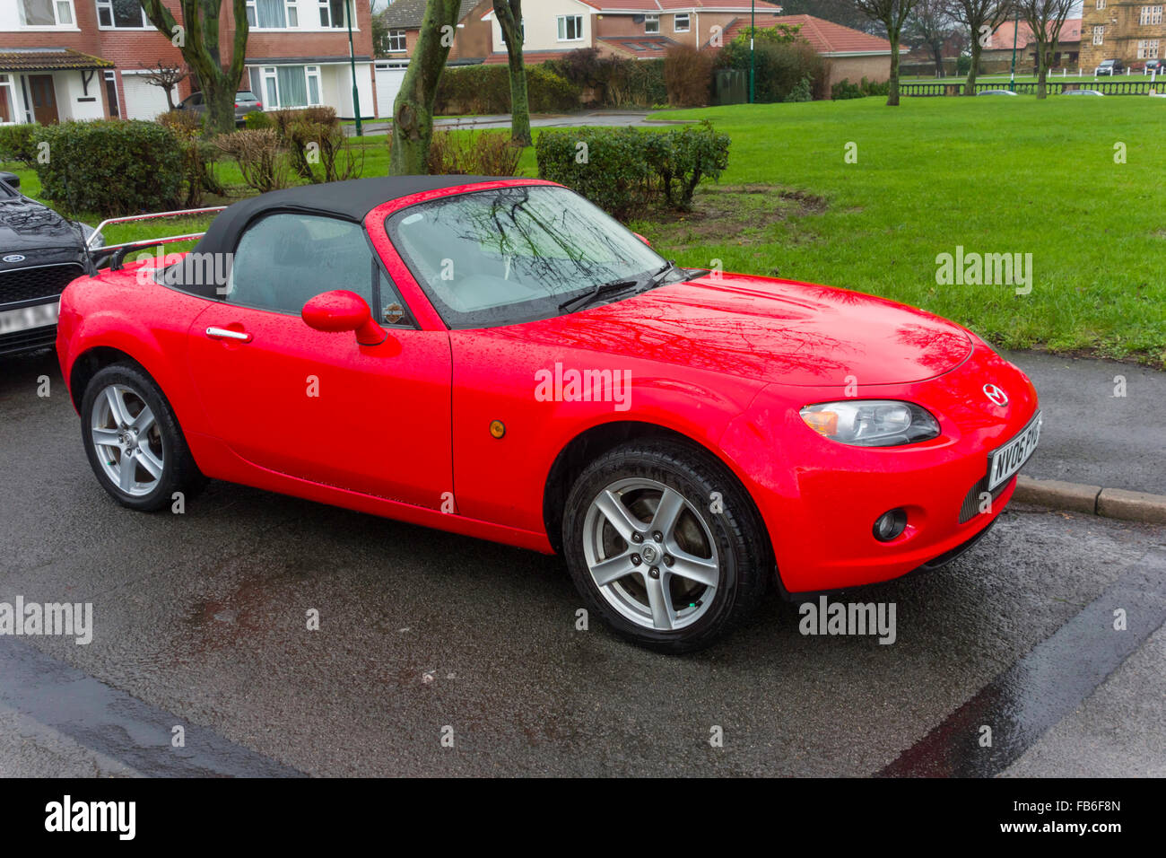 Attractive A Bright Red 2006 Registered Mazda MX 3 Soft Top Sports Car Parked In The  Rain Amazing Design