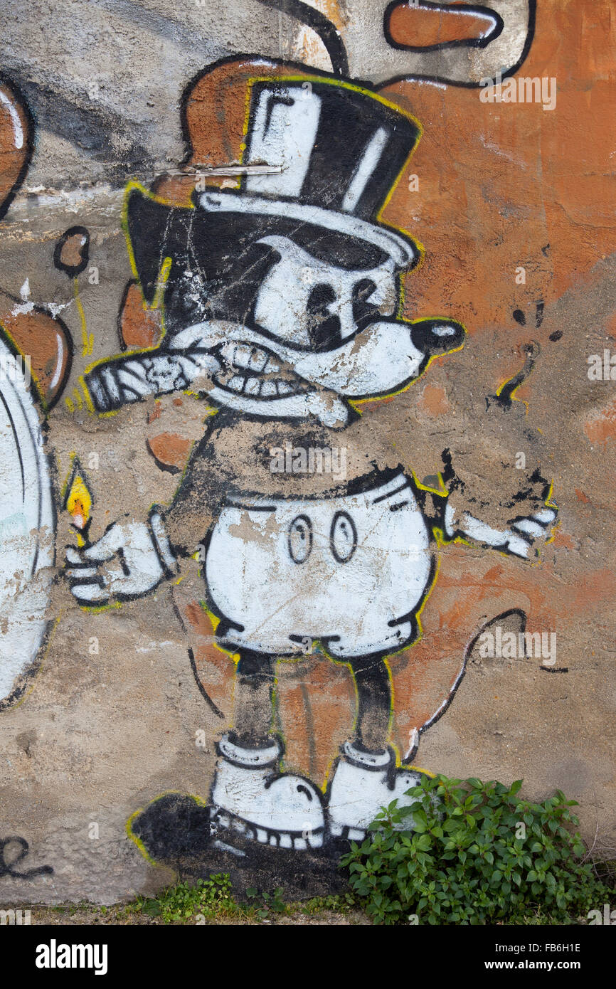 mickey mouse graffiti street art on old quay wall in