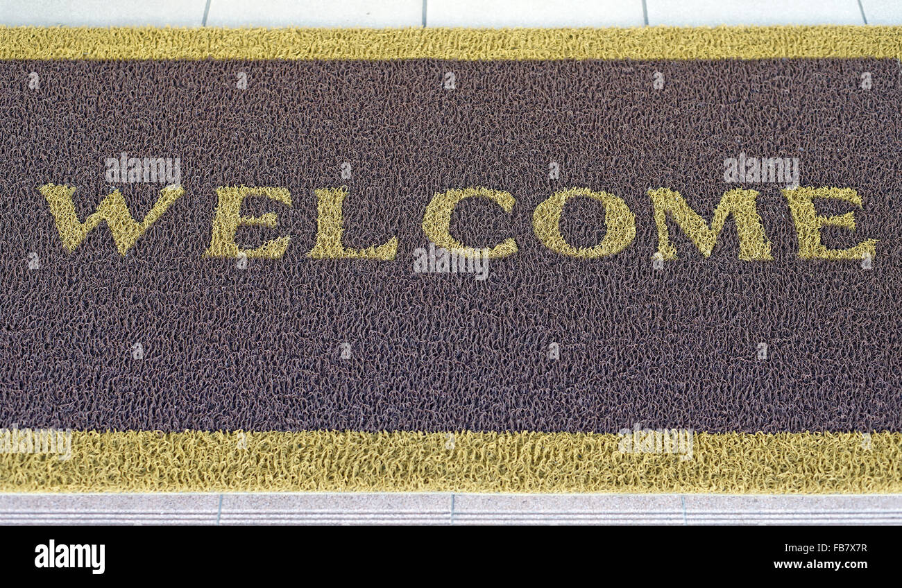 welcome text on brown doormat Stock Photo, Royalty Free Image ...