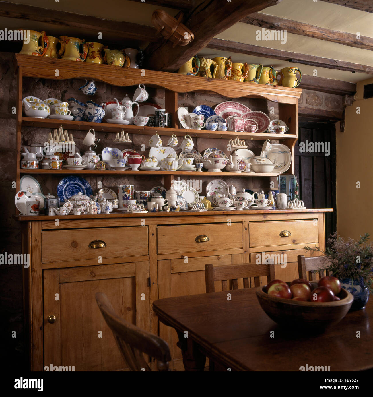 Old Pine Dresser With A Collection Of Vintage China In Cottage Dining Room