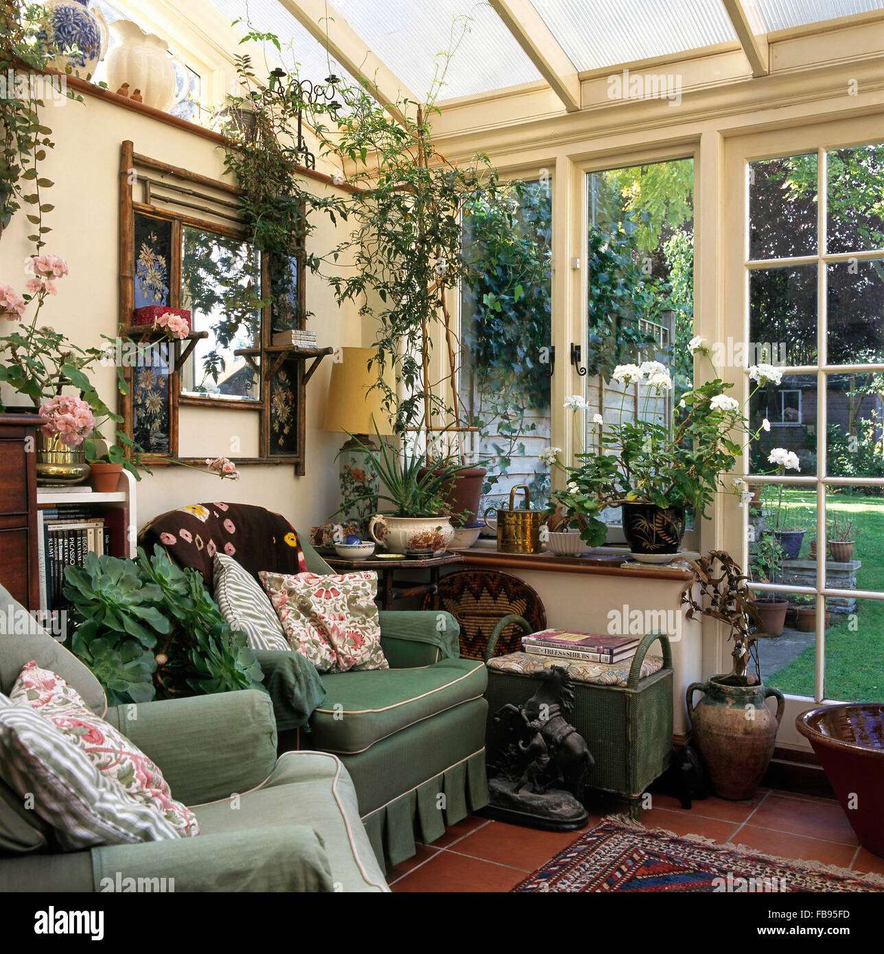 Edwardian Mirror Above Green Armchair In Nineties Conservatory Living Room