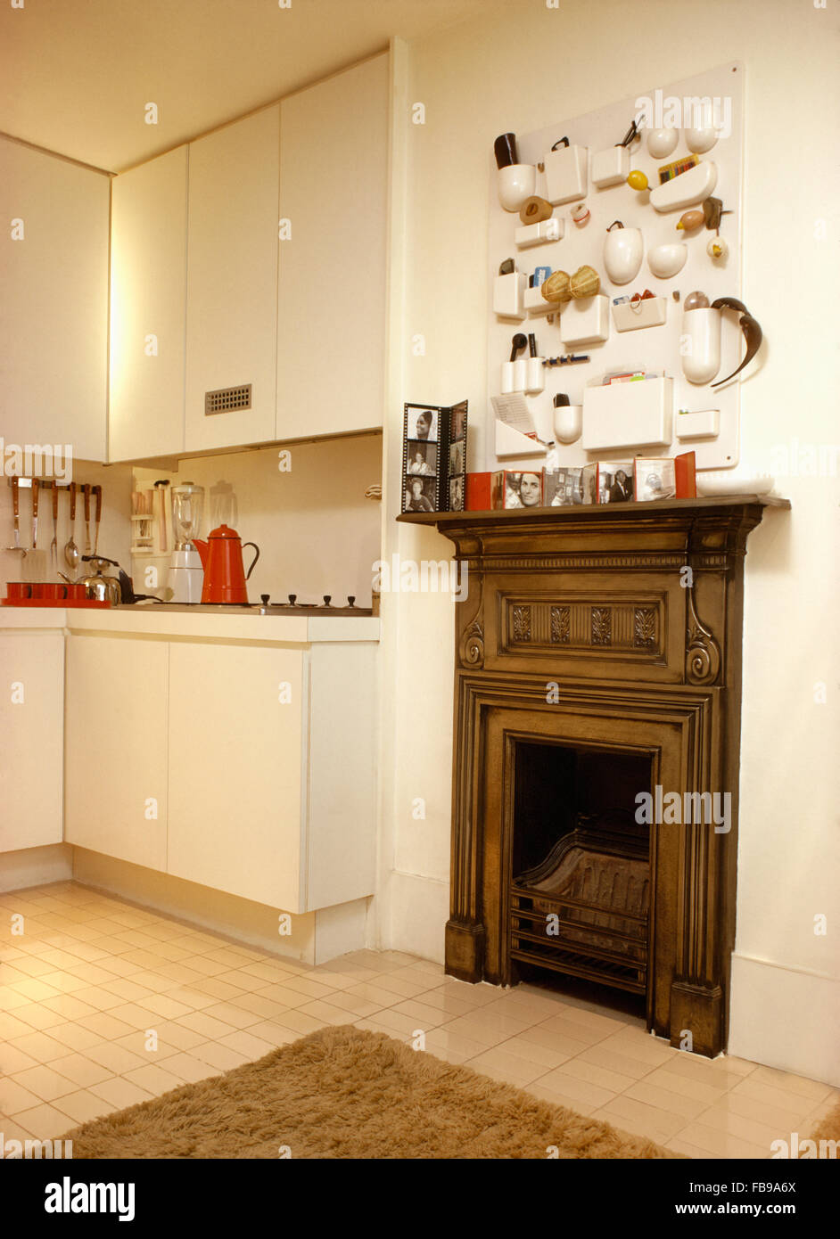 moulded white plastic storage unit above cast iron fireplace in
