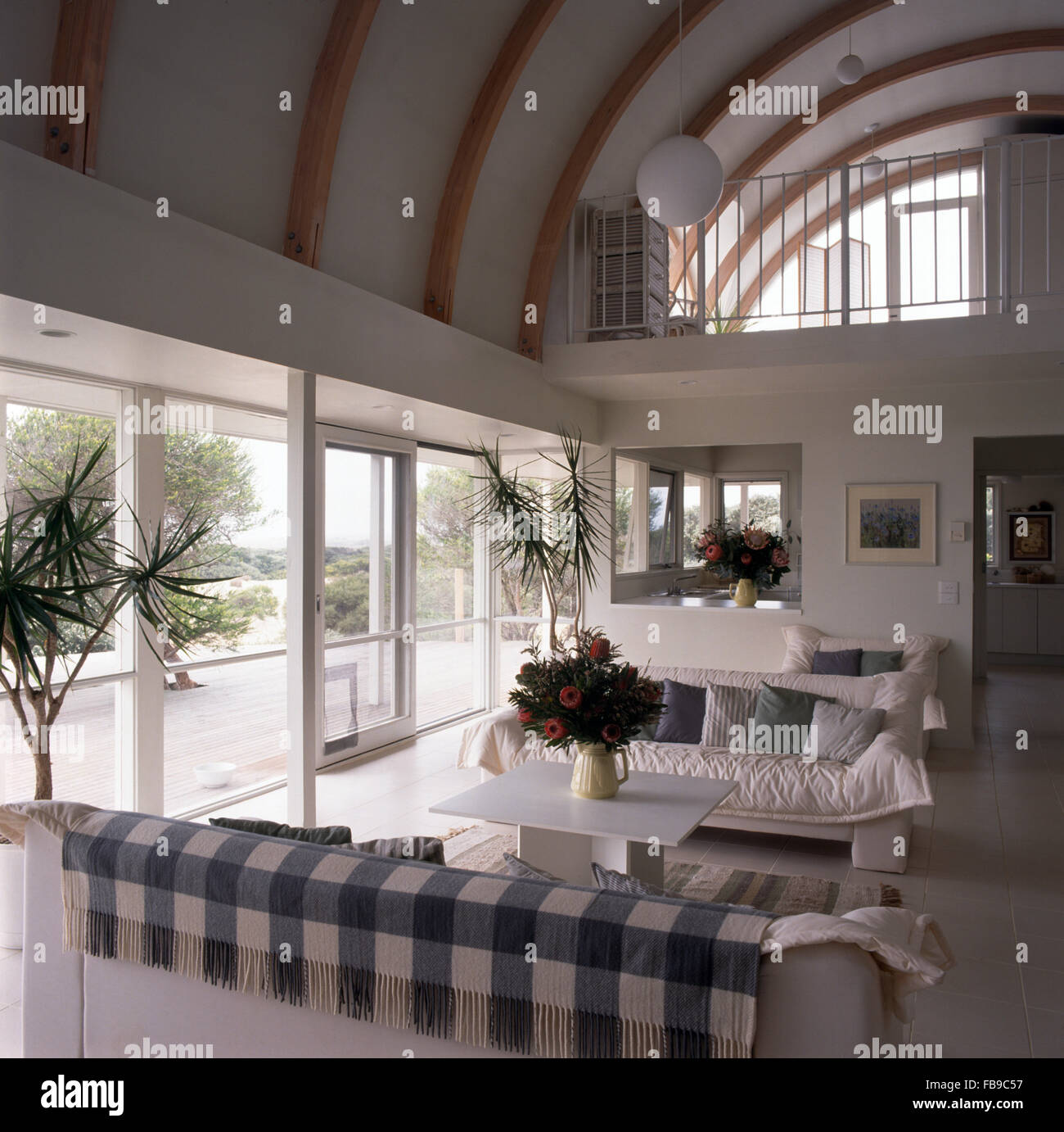 White Sofas In A Large Double Height Living Room With A