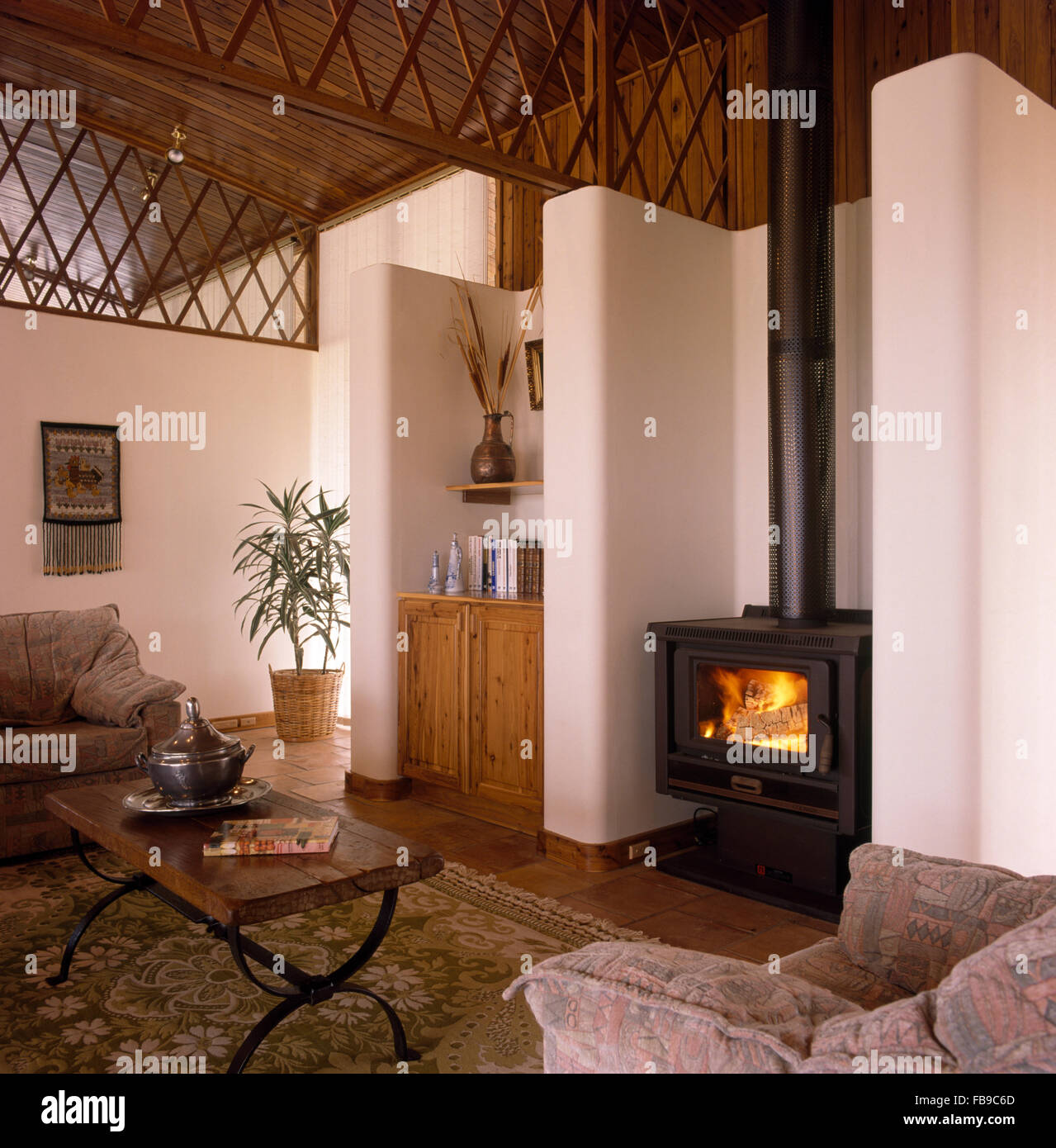 Wood Burning Stove In Living Room With Open Wooden Fretwork Panel On Stock Photo Royalty Free