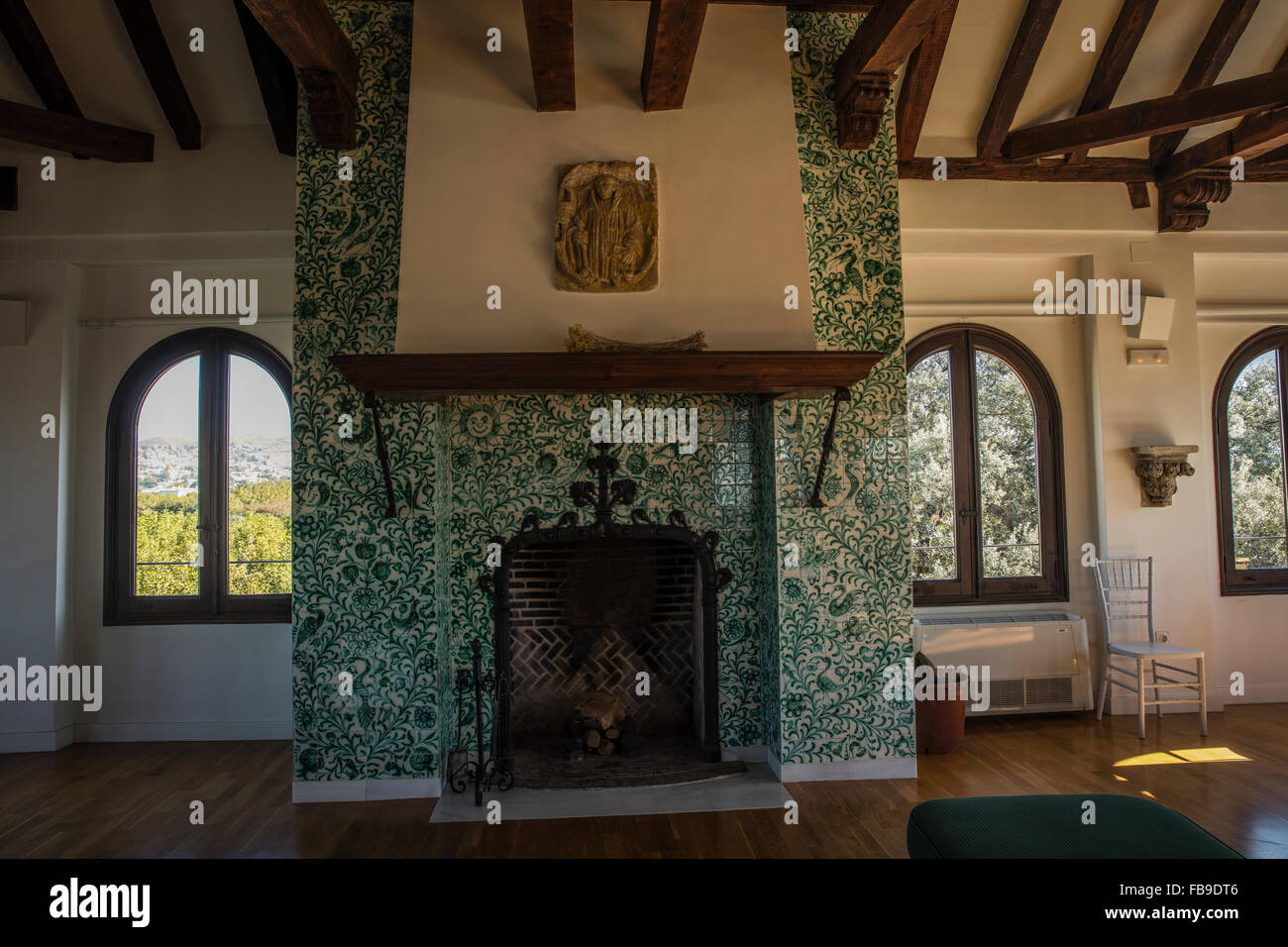 spanish dining room with fireplace hearth and spanish ceramic tile