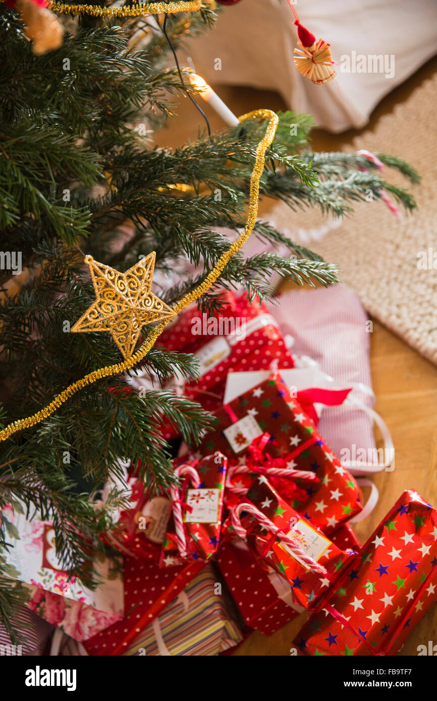 Sweden, High angle view of presents under Christmas tree Stock ...