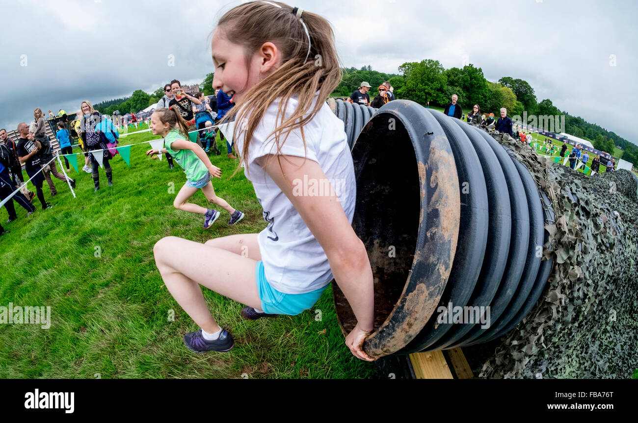 Shoot the fruit - Action In The Fruit Shoot Mini Mudder Challenge At Drumlanrig Castle Dumfries And Galloway Scotland