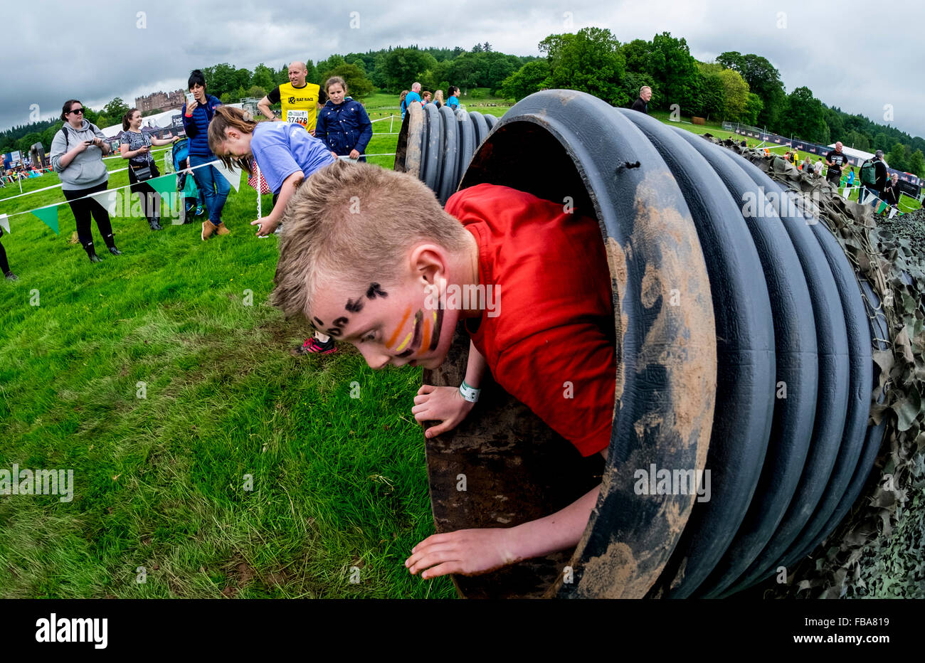 Shoot the fruit -  Action In The Fruit Shoot Mini Mudder Challenge At Drumlanrig Castle Dumfries And Galloway