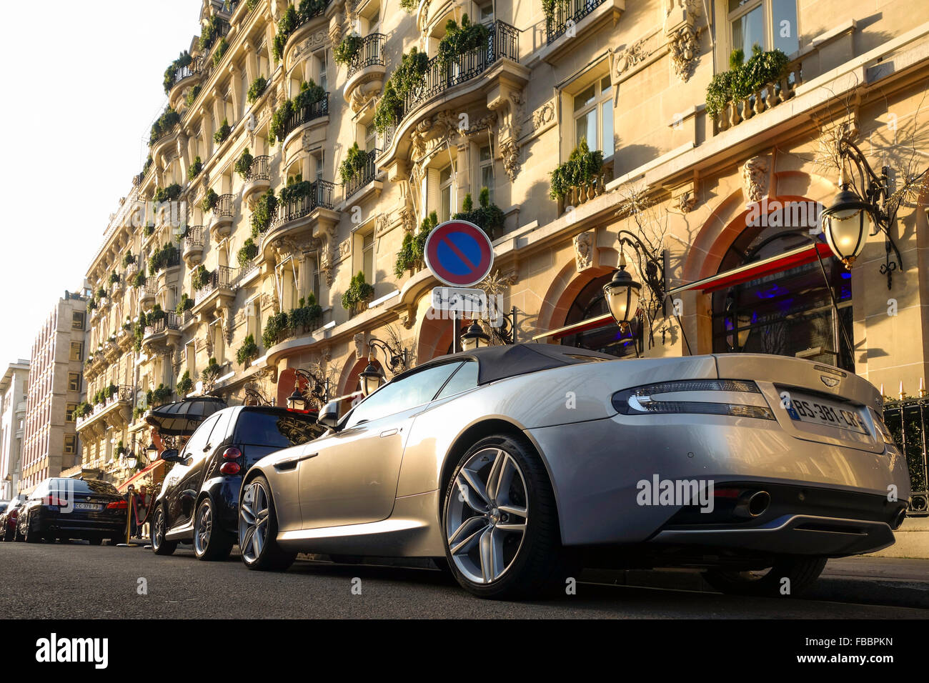 aston martin parked in front of luxury 5 star hotel plaza ath n e stock photo royalty free. Black Bedroom Furniture Sets. Home Design Ideas