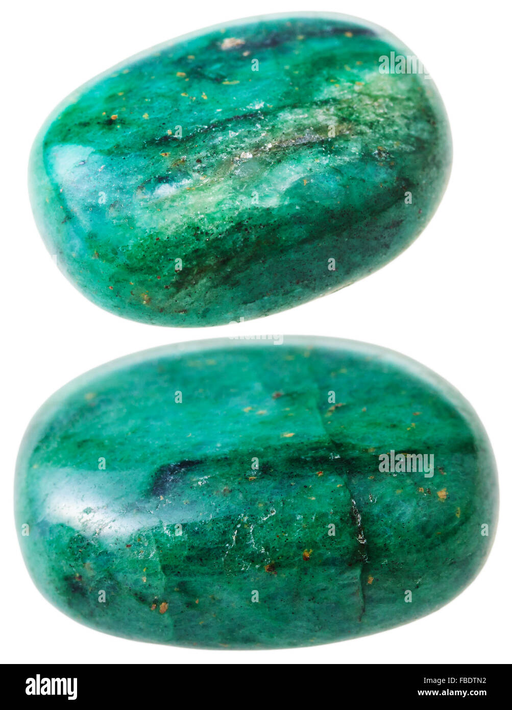 natural mineral gem stone - two green beryl gemstone pebbles ...