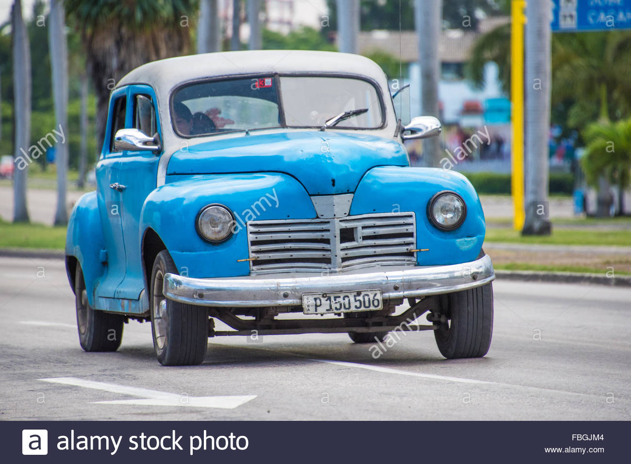 Old vintage cars vehicles in moving action Havana,Cuba. The old ...